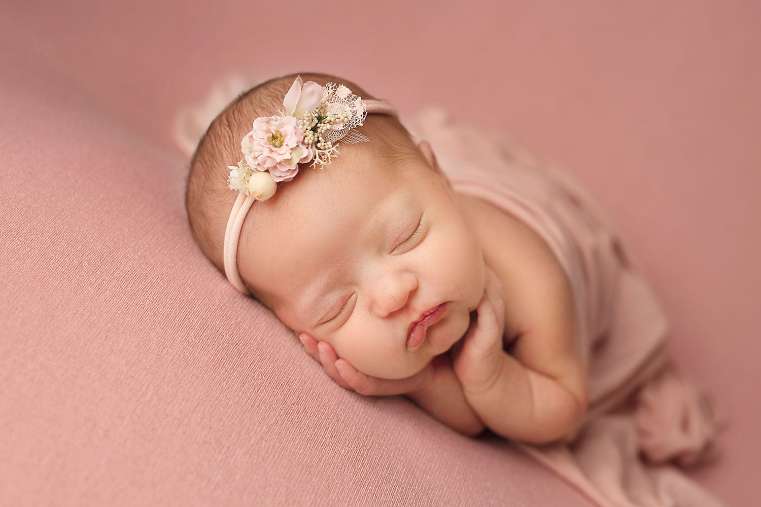 newborn girl on pink backdrop by Annie Whitaker Photography