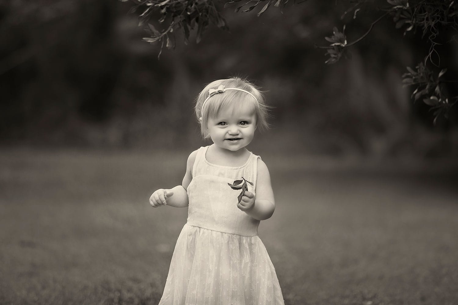 black and white photo of one year old girl by Annie Whitaker Photography