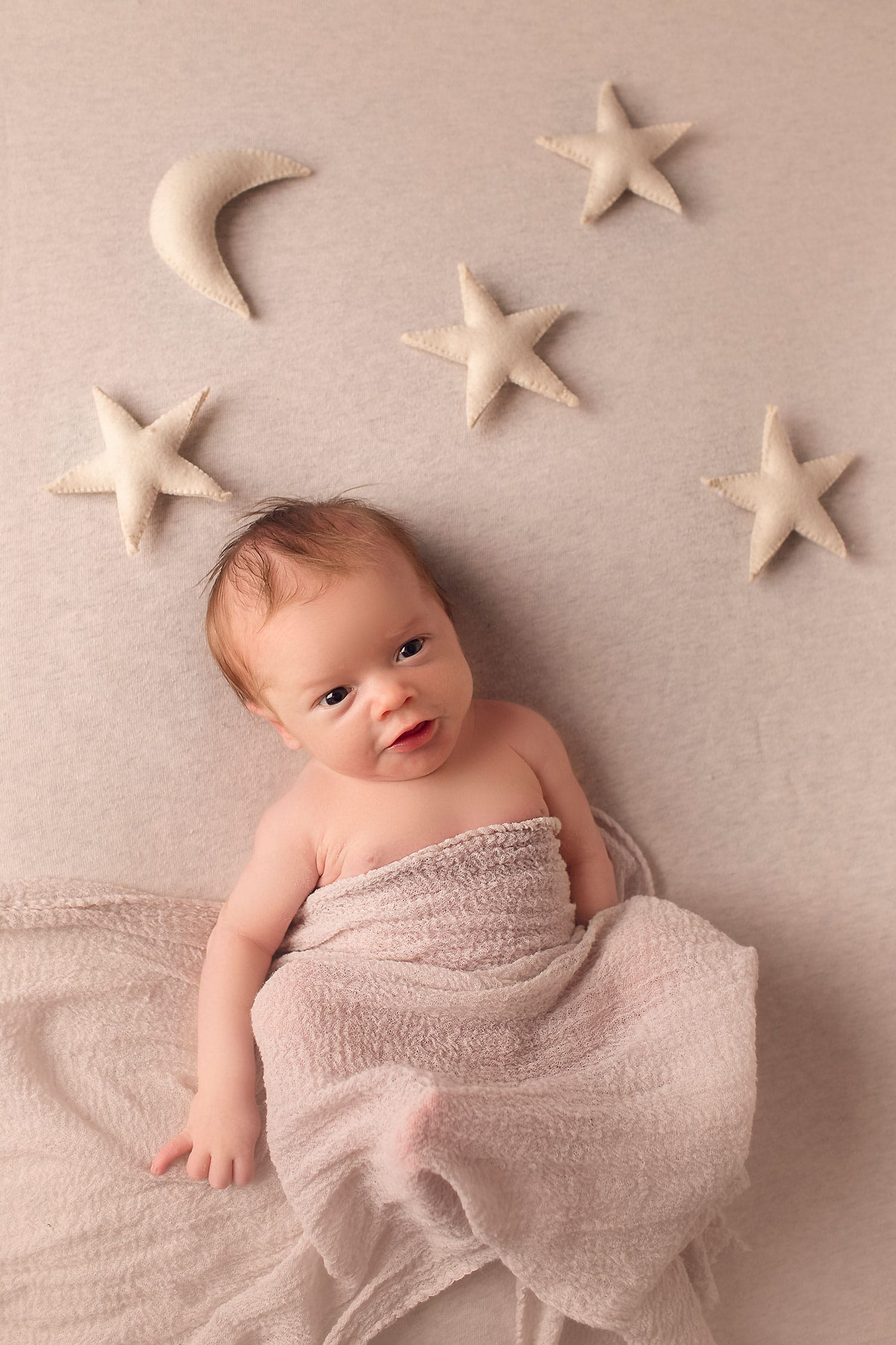 newborn boy with stars and moon by Annie Whitaker Photography