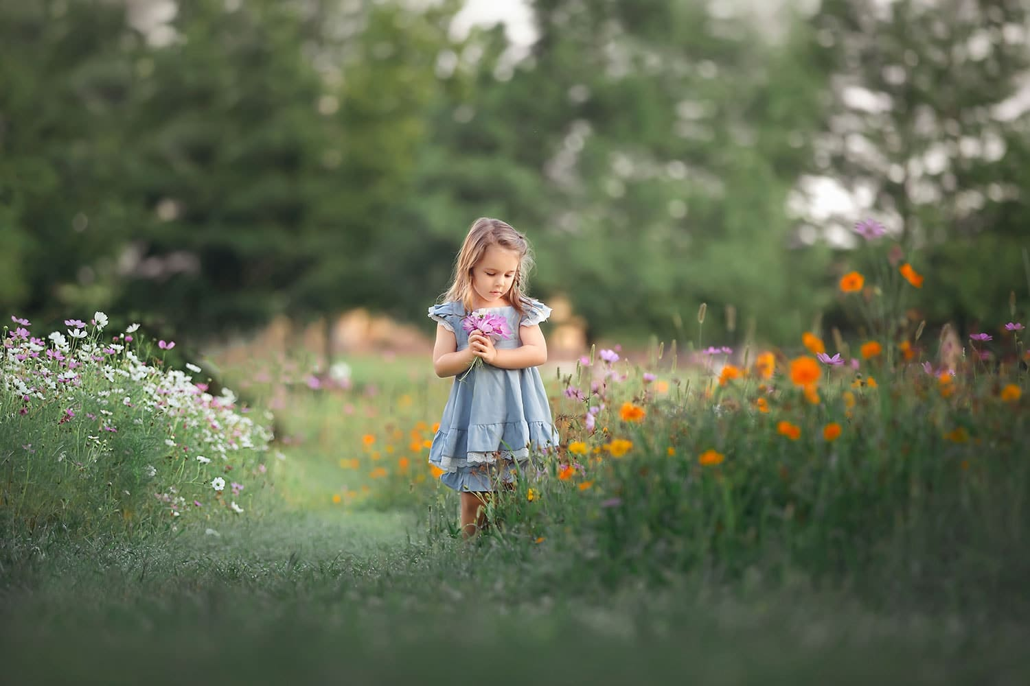 Toddler holding wildflowers in New Orleans by Annie Whitaker Photography