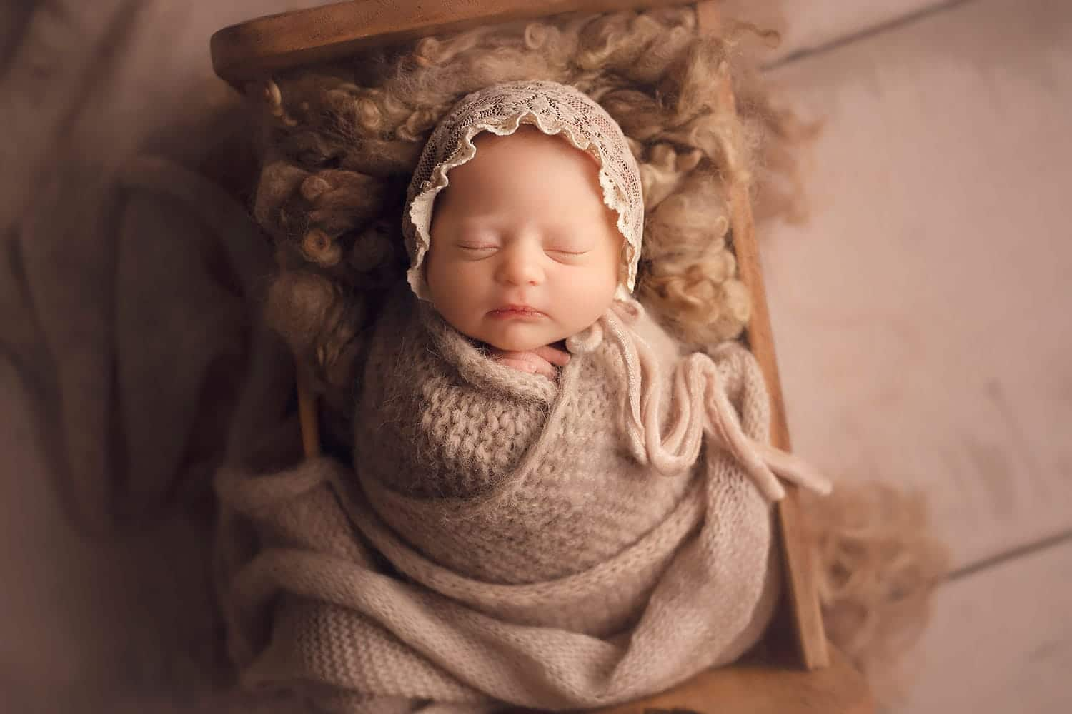 newborn baby in tan set up by Annie Whitaker Photography