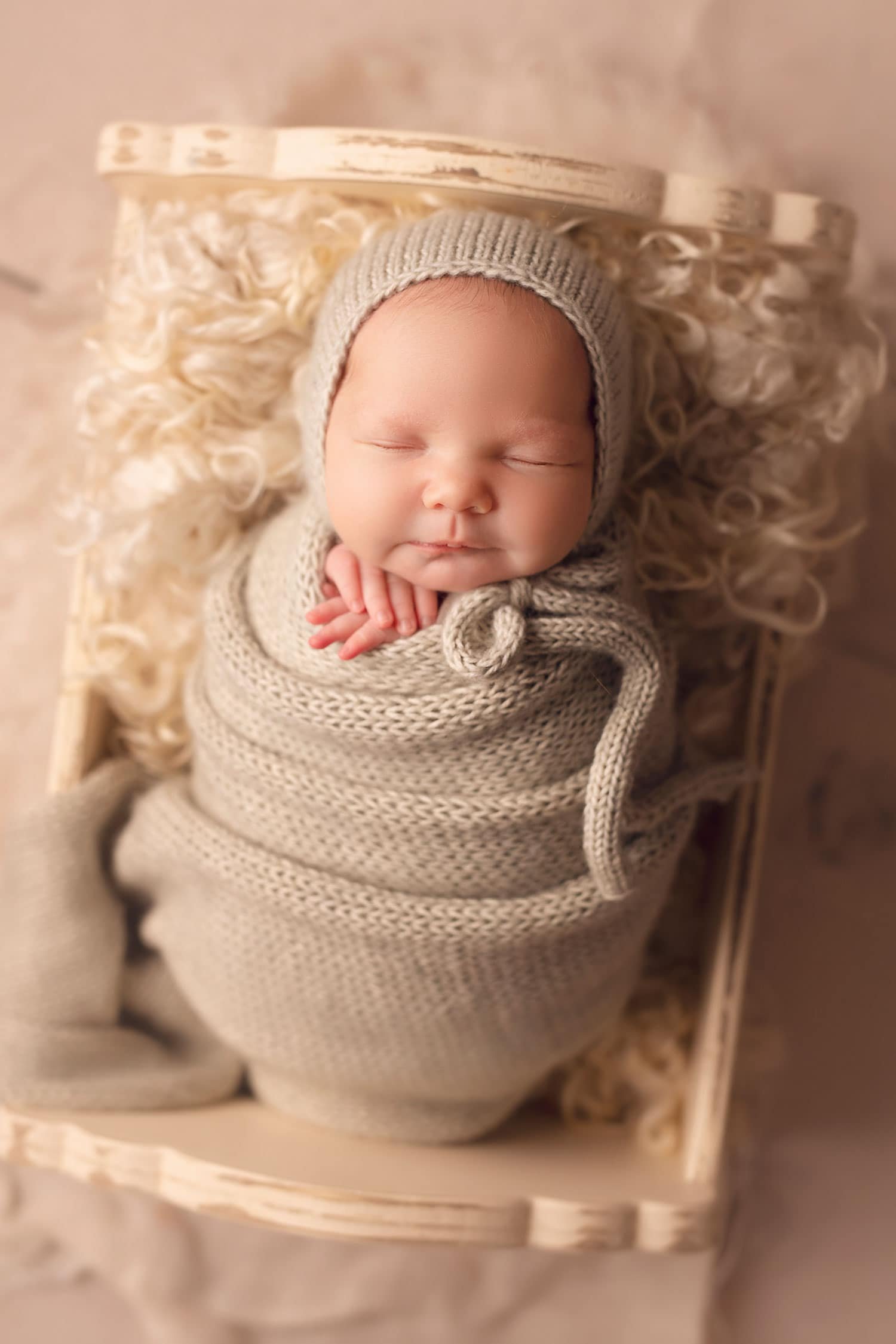 newborn baby girl in green wrap by Annie Whitaker Photography
