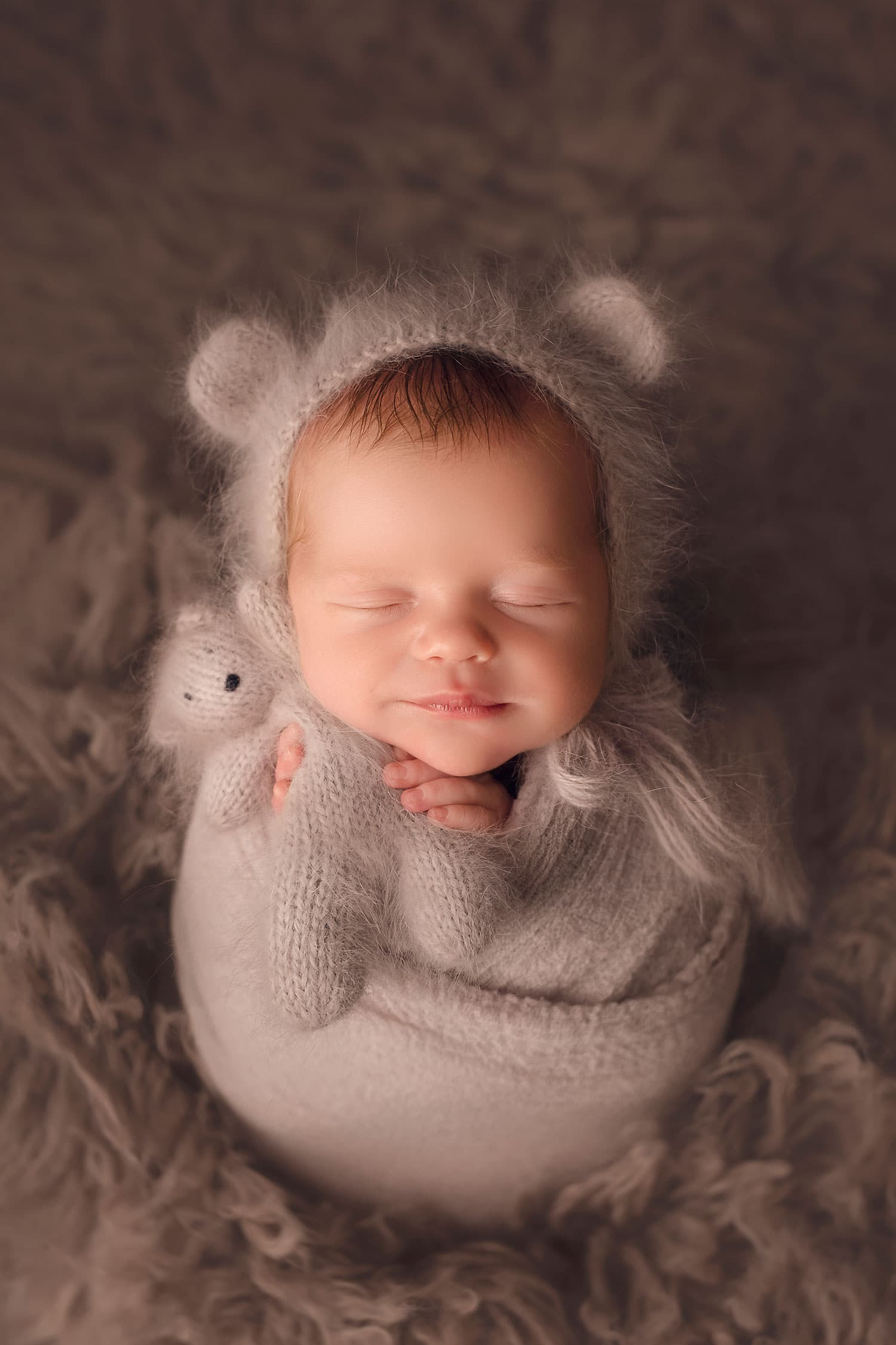 newborn boy in potato sac pose by Annie Whitaker Photography