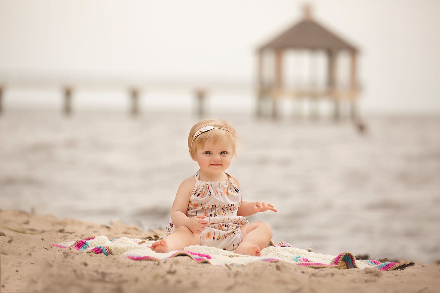 One year girl at beach by Annie Whitaker Photography