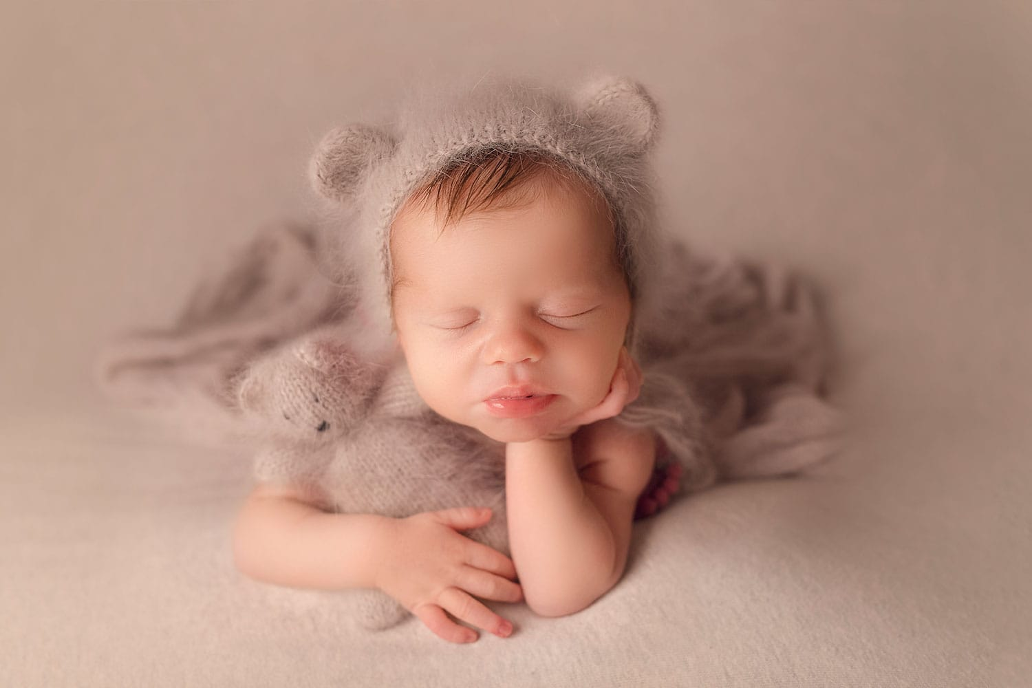newborn boy in froggy pose with bear bonnet by Annie Whitaker Photography