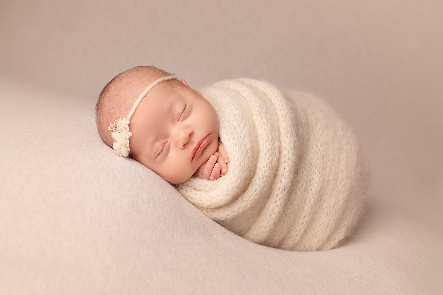 baby girl in cream wrap by Annie Whitaker Photography