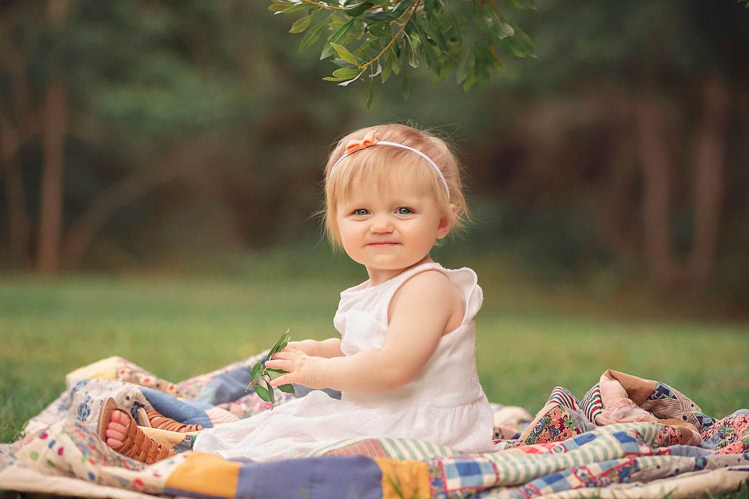 Baby girl on quilt by Annie Whitaker Photography