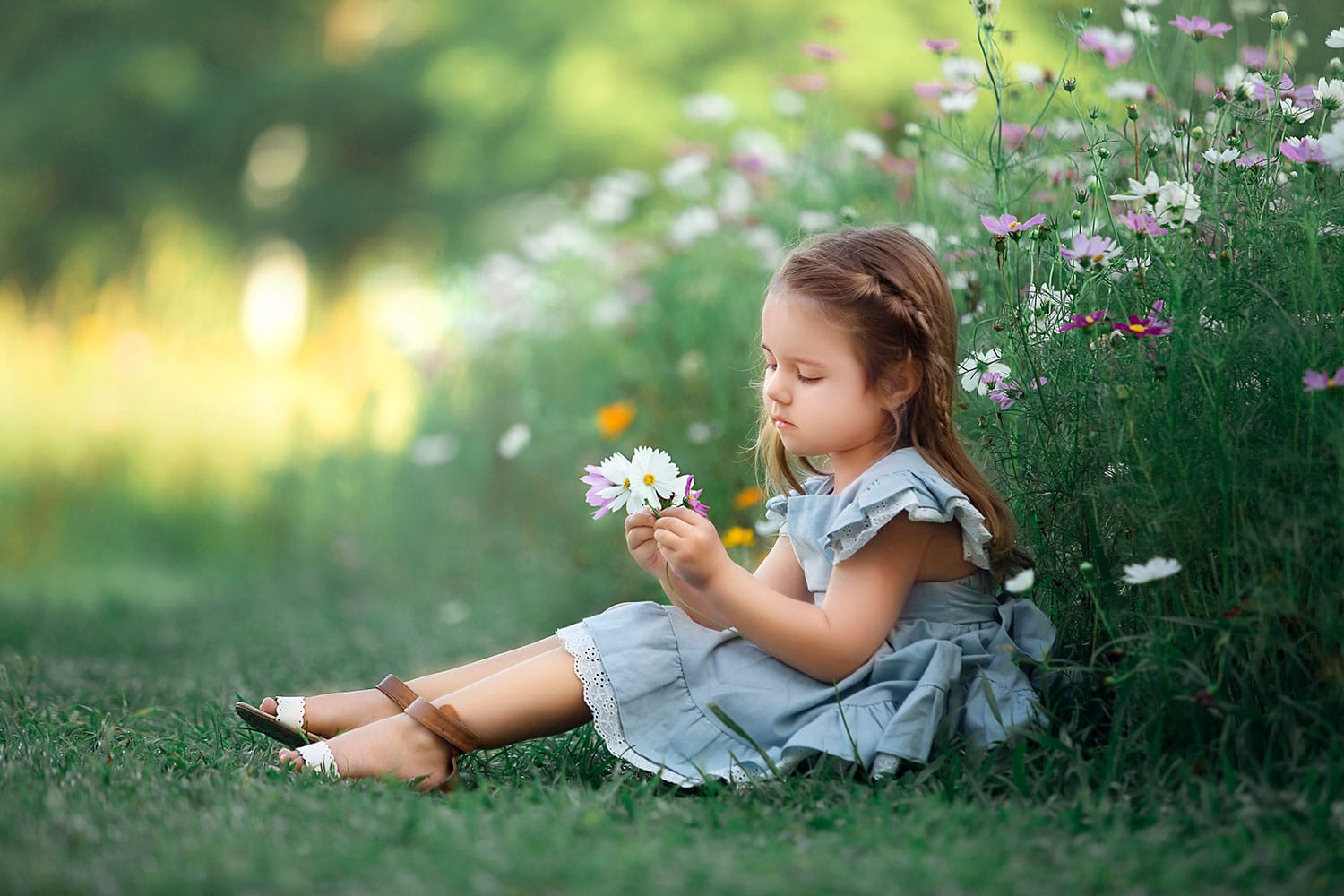 Beautiful little girl in wildflowers by Annie Whitaker Photography