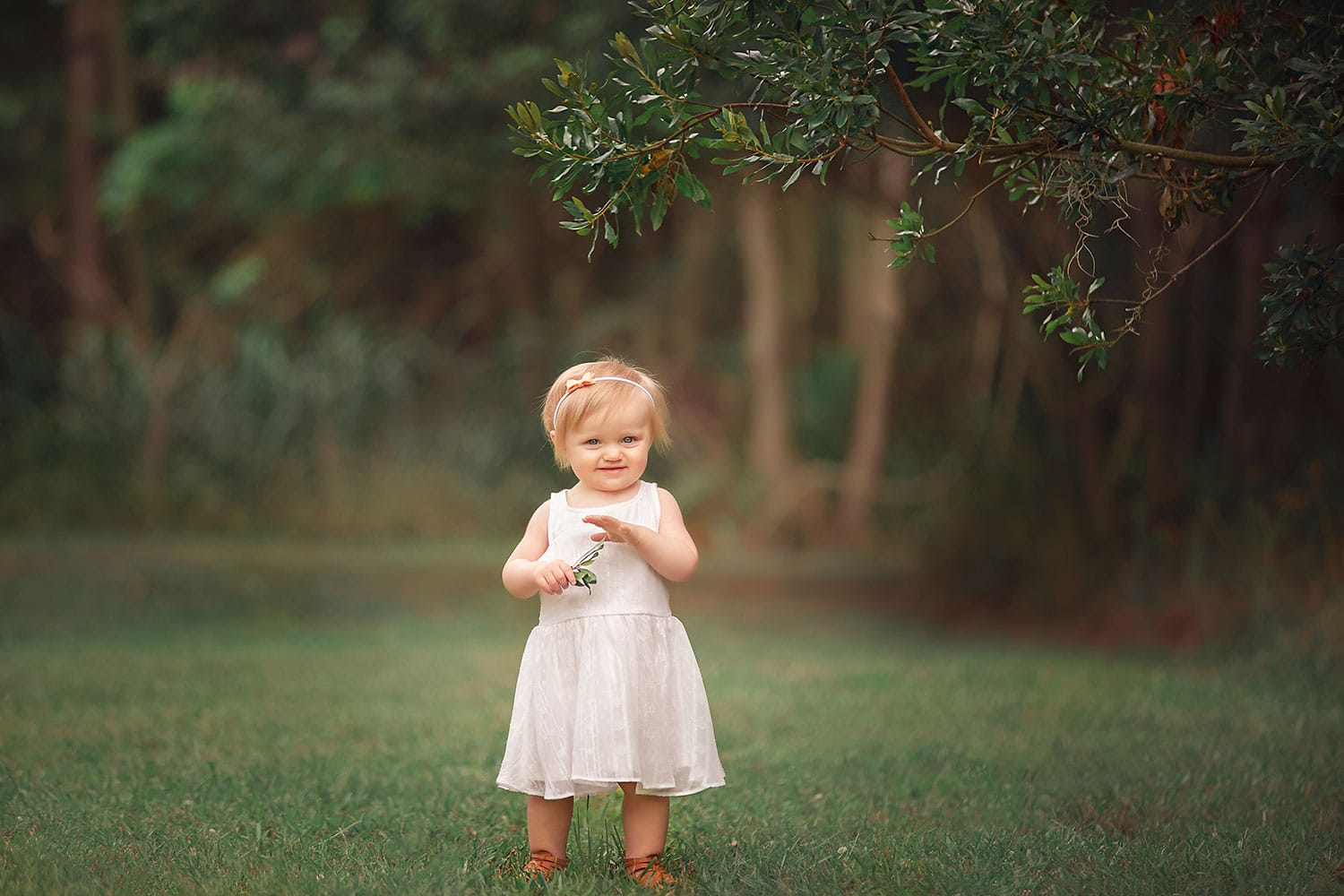 One year old girl in white dress by Annie Whitaker Photography