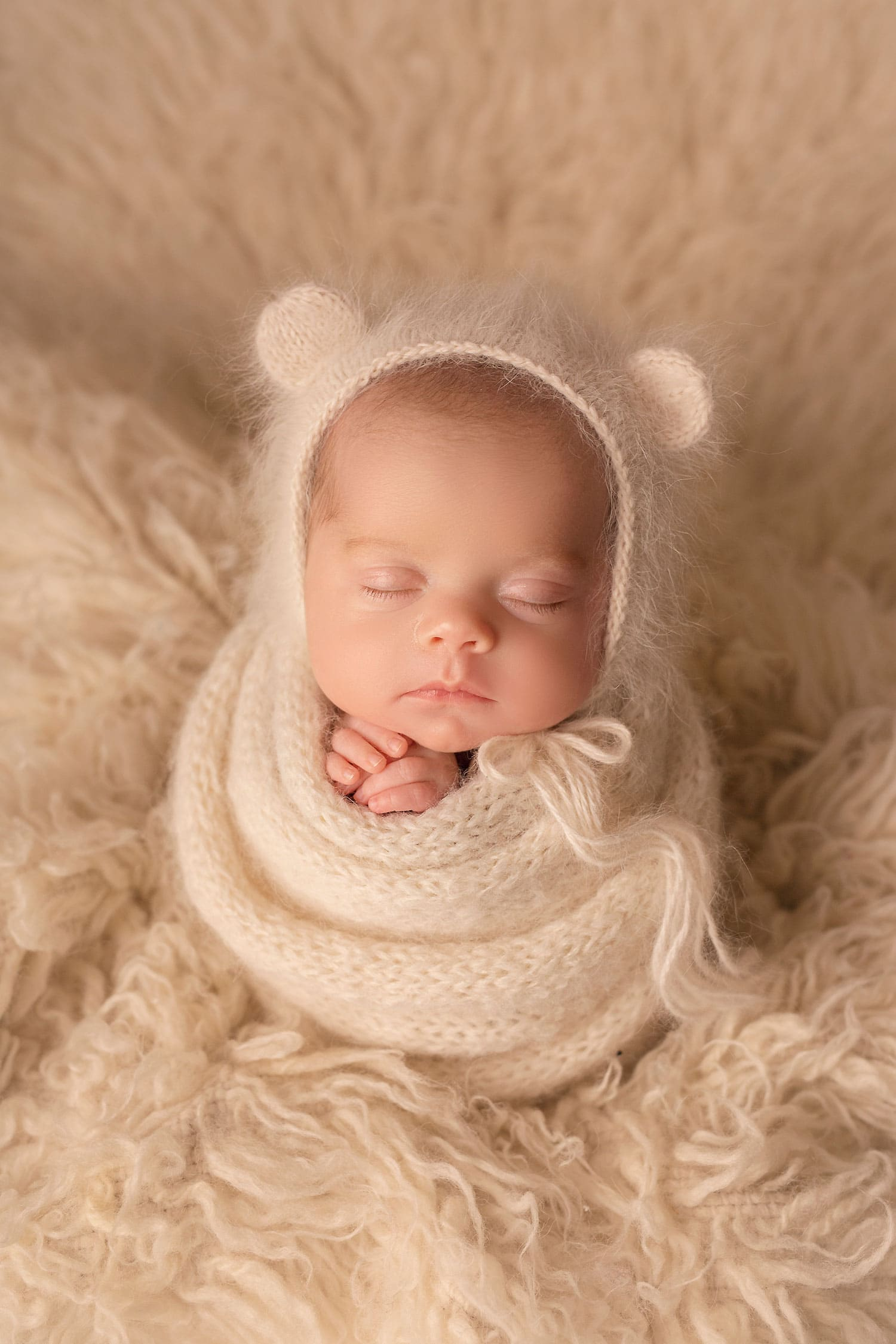 newborn girl in bear bonnet by Annie Whitaker Photography