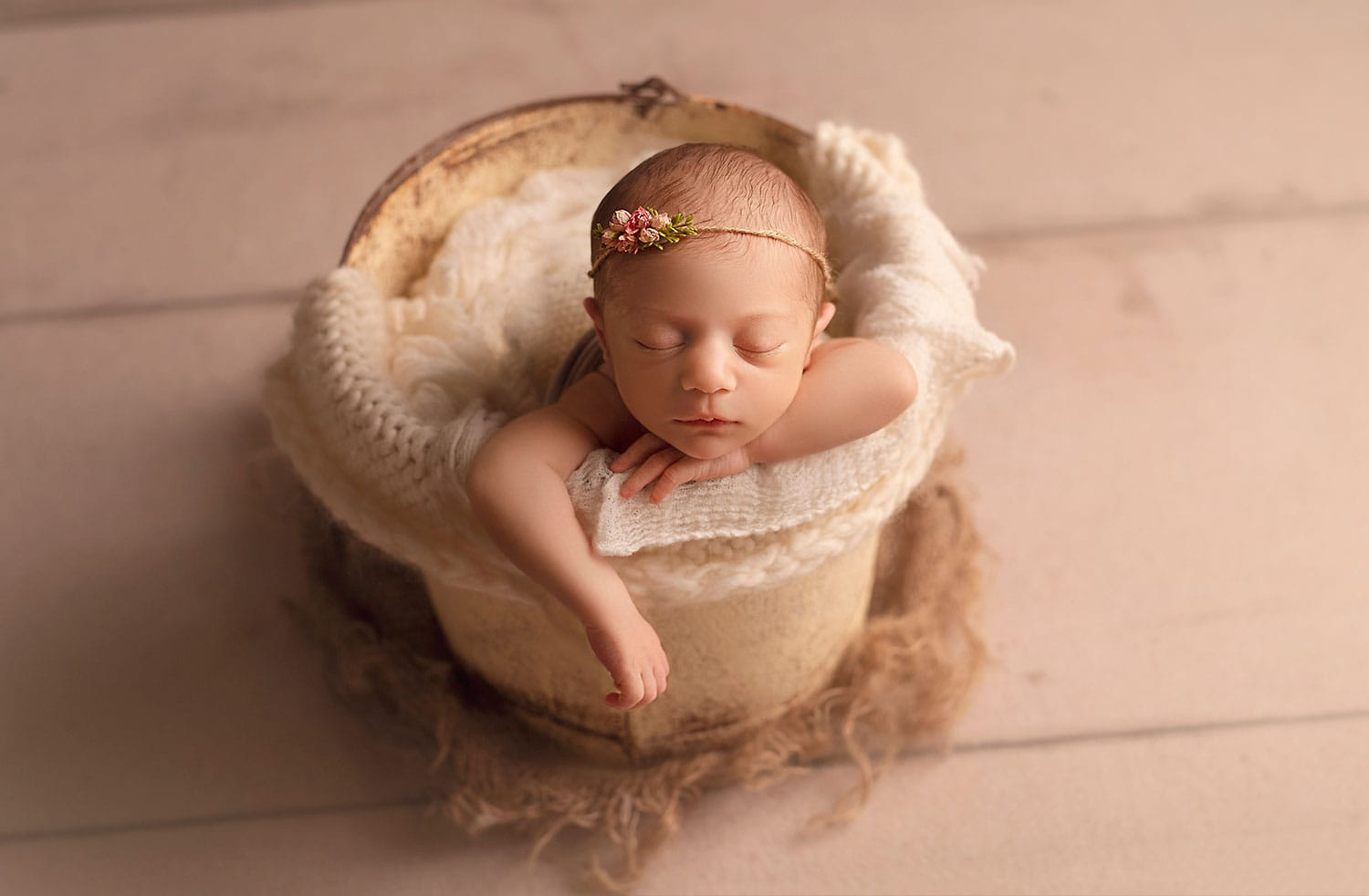 baby girl in bucket pose by Annie Whitaker Photography