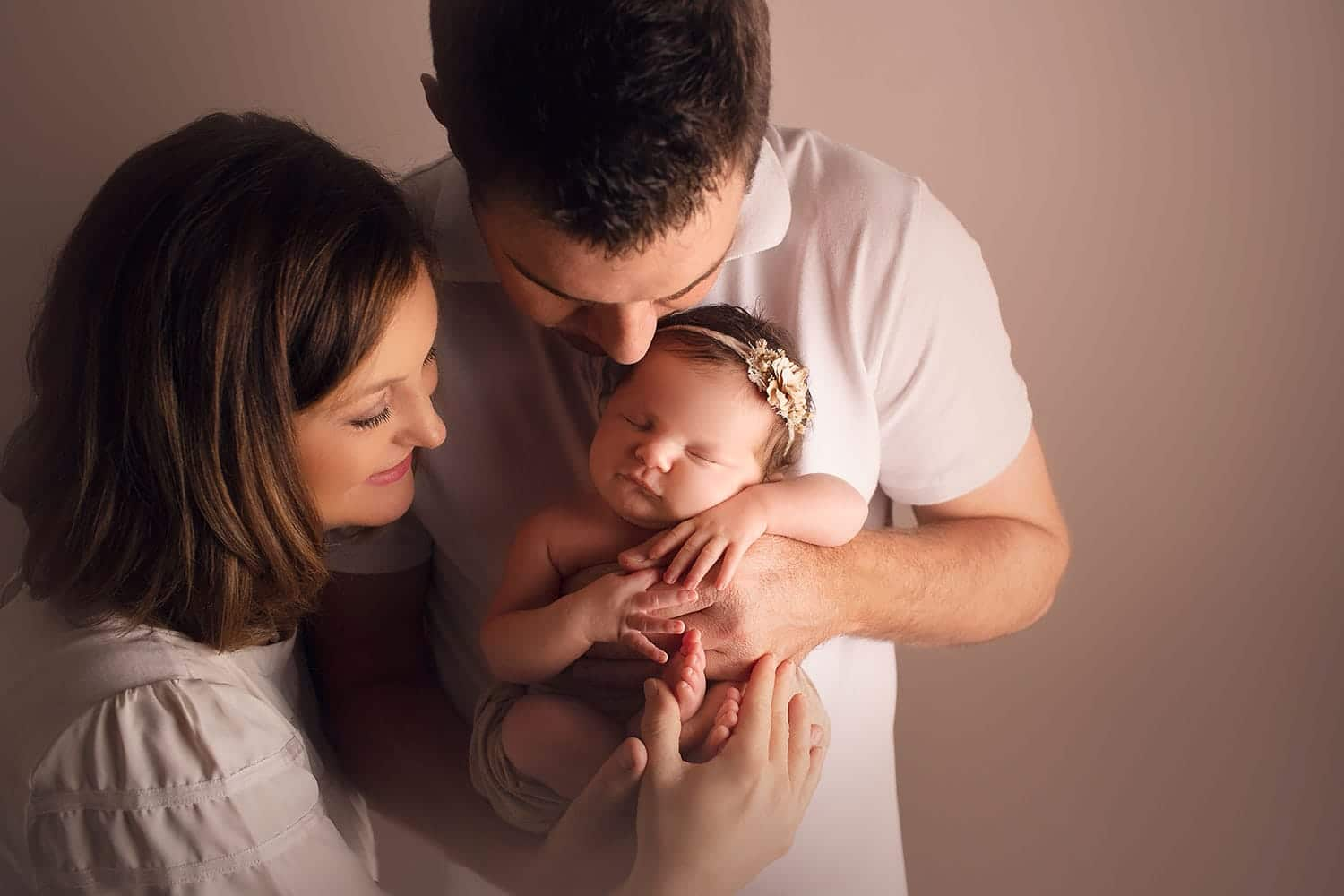 mom and dad with newborn by Annie Whitaker photography