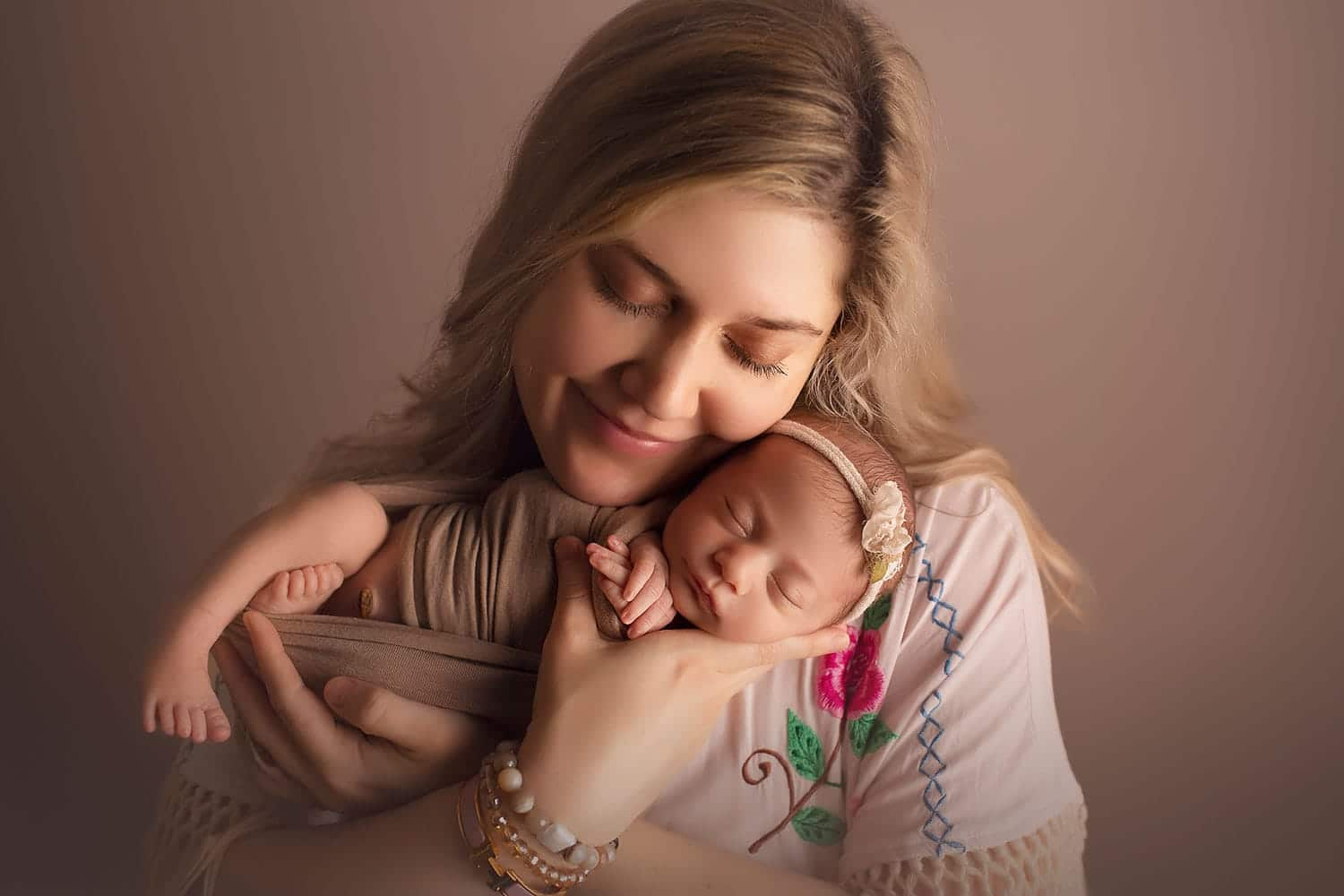 mother holding newborn by Annie Whitaker Photography