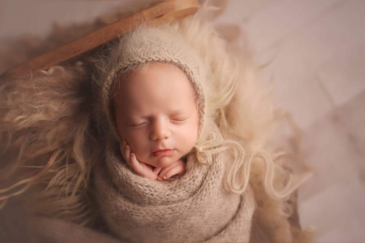 newborn girl in tan bonnet and wrap by Annie Whitaker Photography