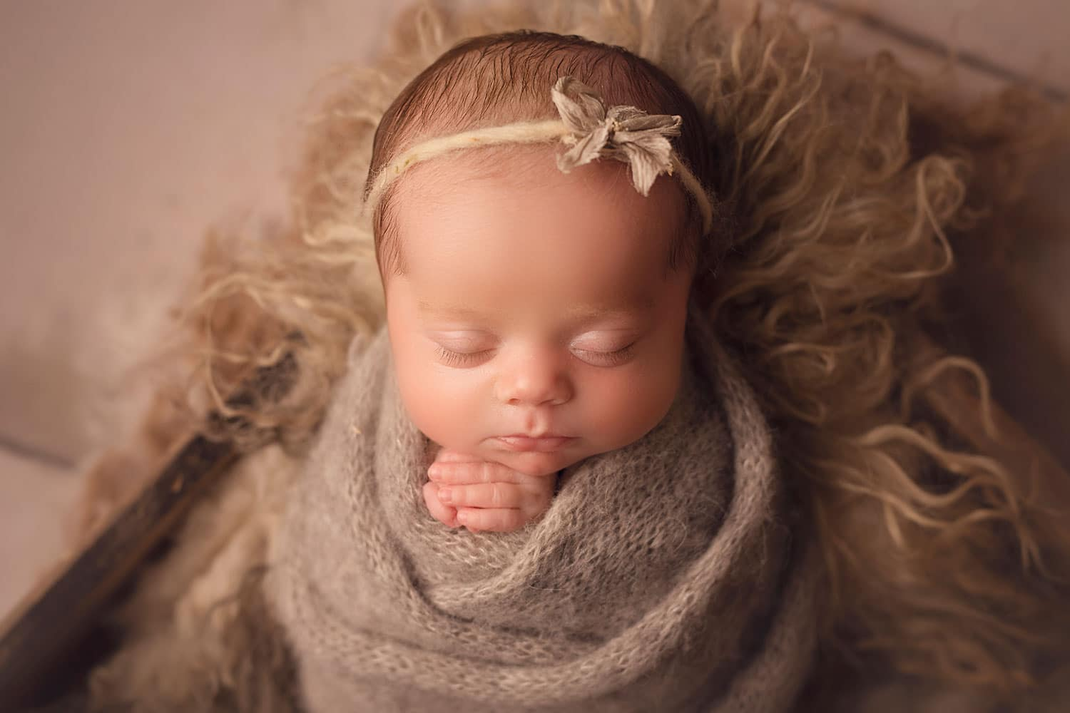 baby girl in gray wrap by Annie Whitaker Photography