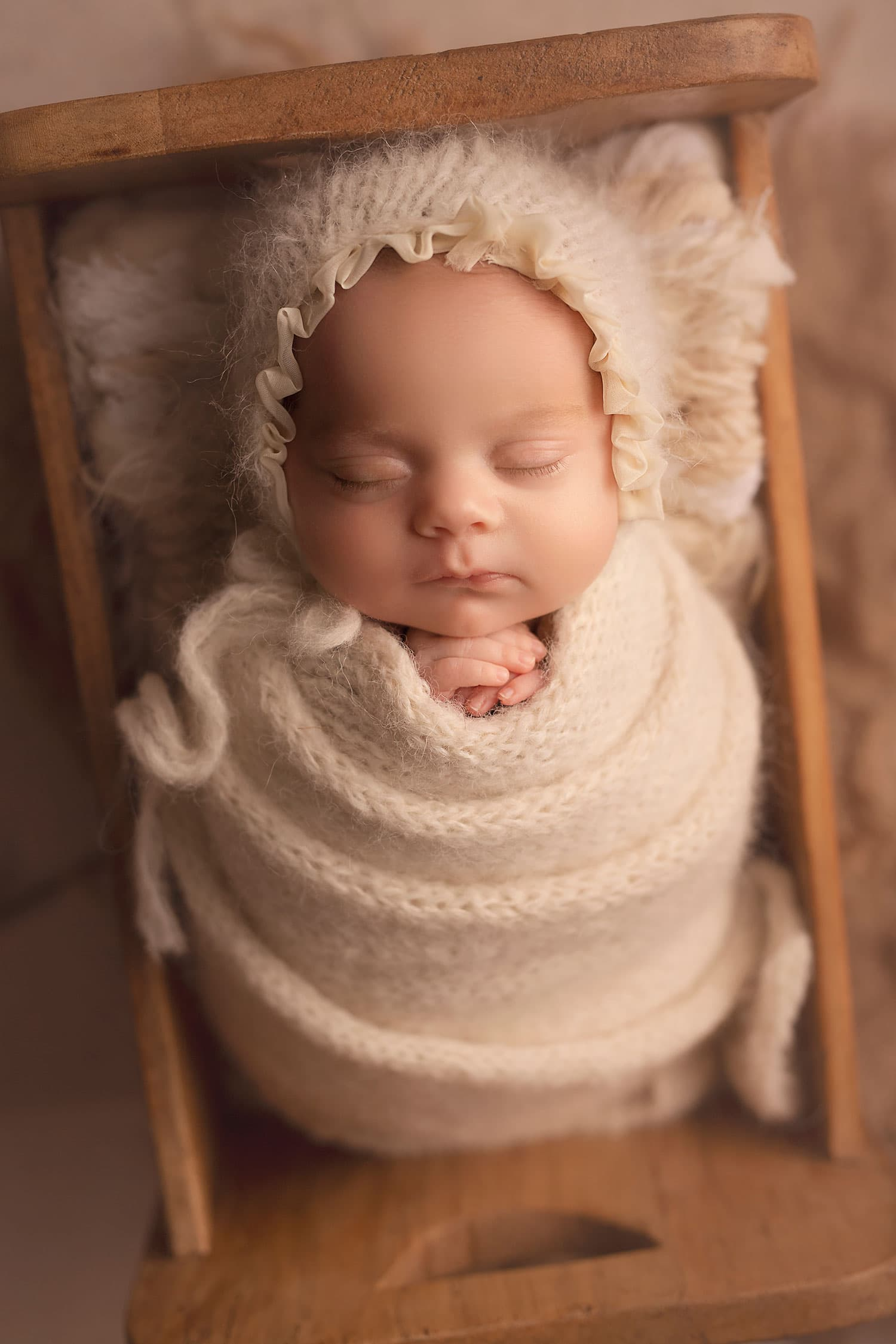 beautiful newborn girl in all cream set up by Annie Whitaker Photography
