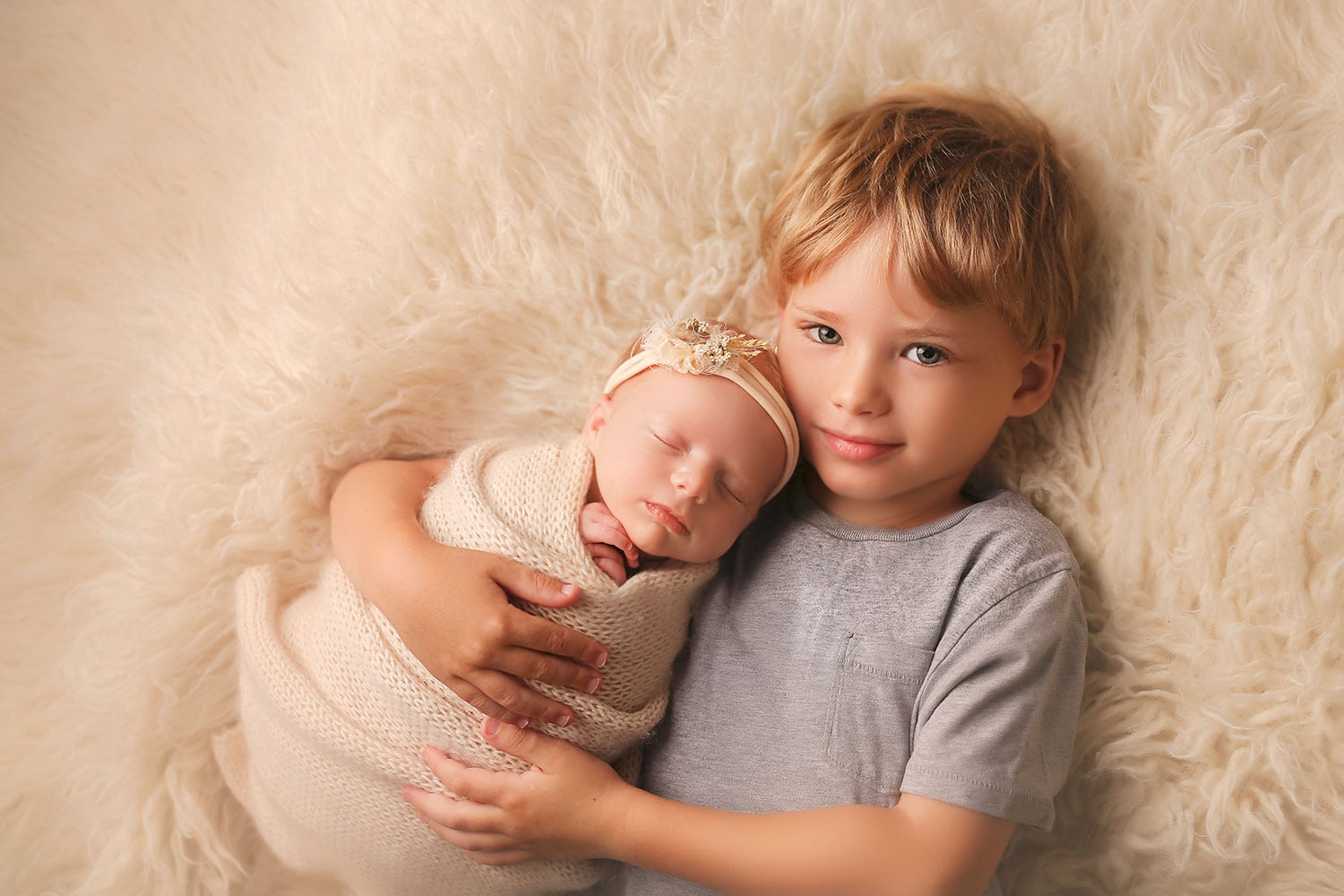 big brother holding newborn sister by Annie Whitaker Photography