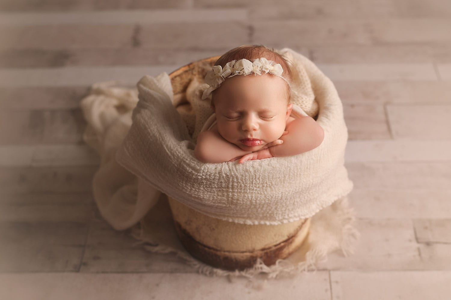 Newborn girl in bucket pose by Annie Whitaker Photography