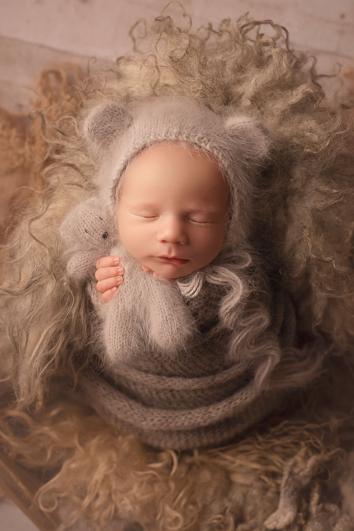 baby boy holding tiny bear in bear bonnet by Annie Whitaker Photography
