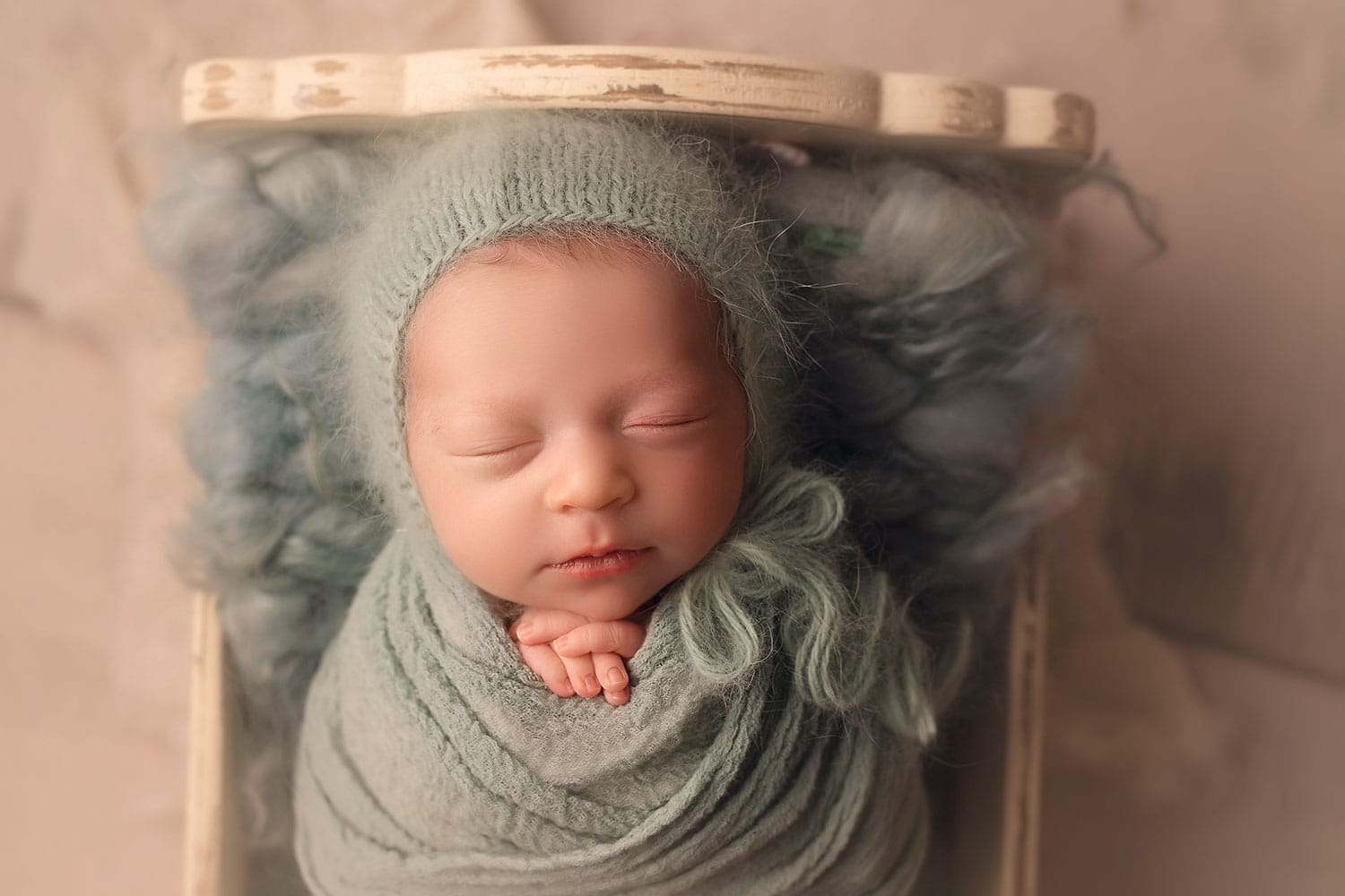 Baby girl in soft blue fluff by Annie Whitaker Photography