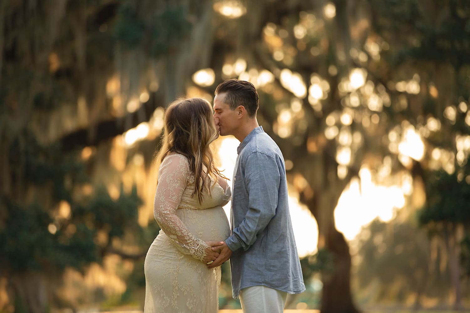Beautiful expecting couple at sunset by Annie Whitaker Photography