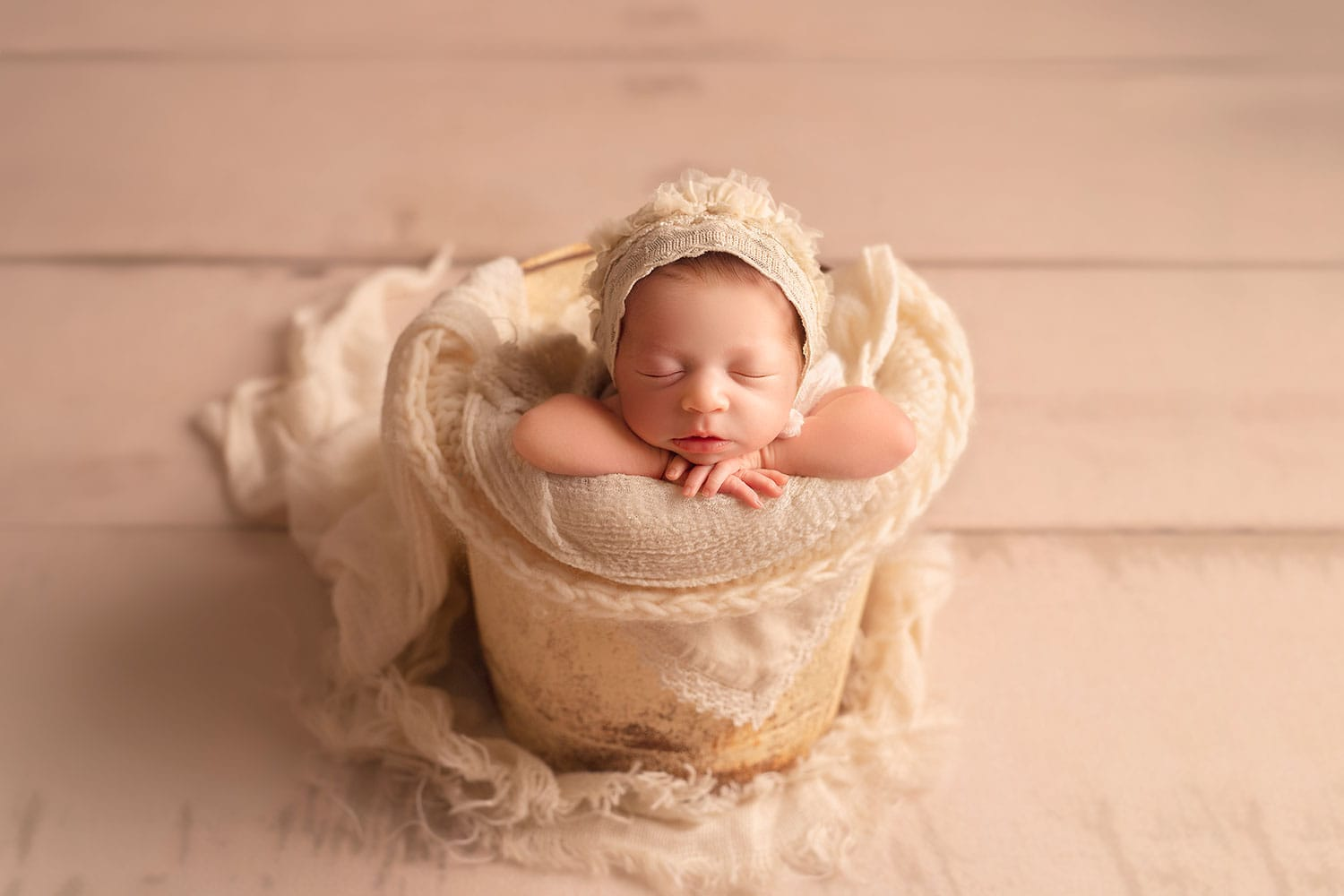 All cream newborn bucket pose set up by Annie Whitaker Photography