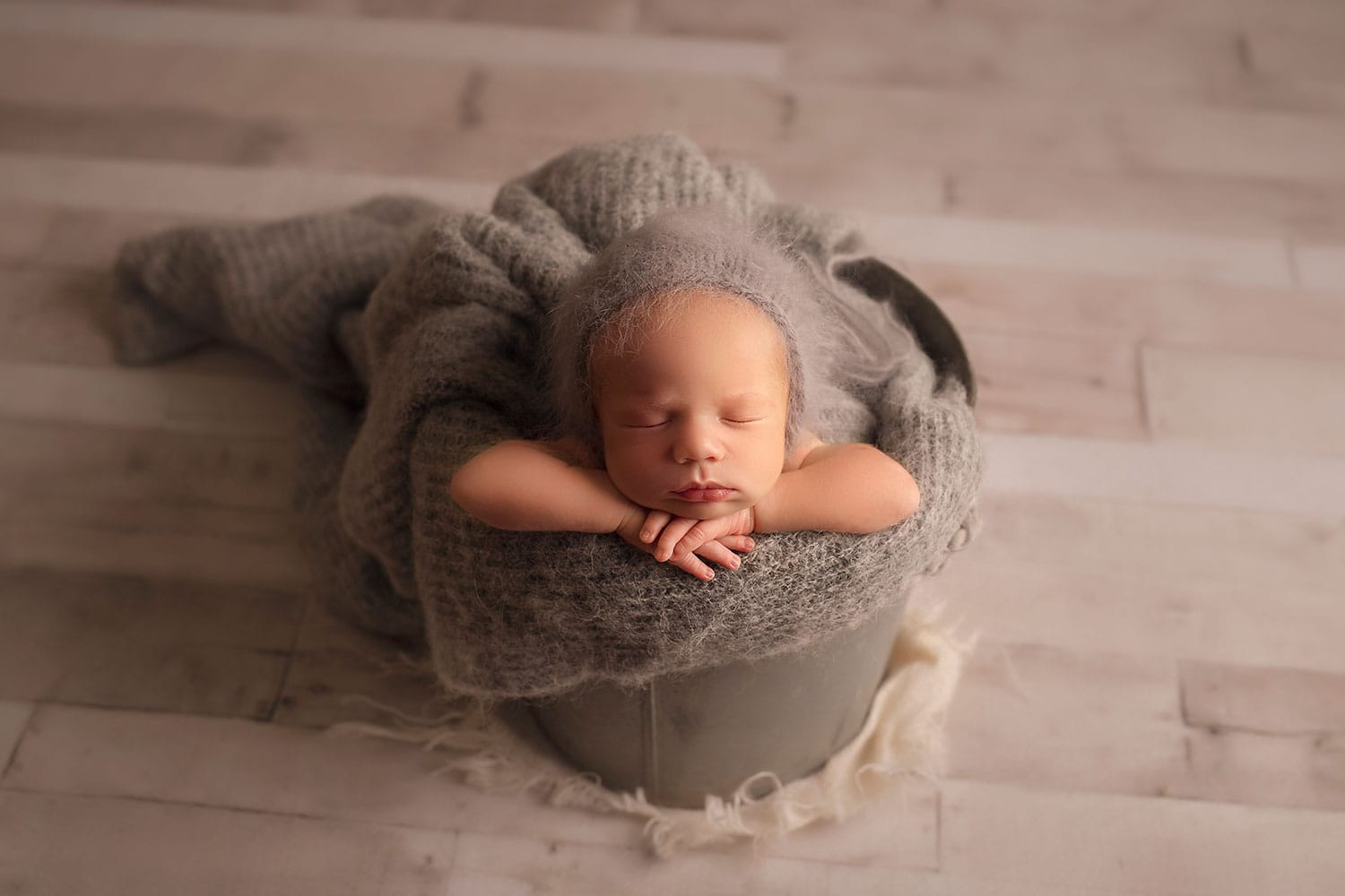 newborn boy in all gray set up by Annie Whitaker photography