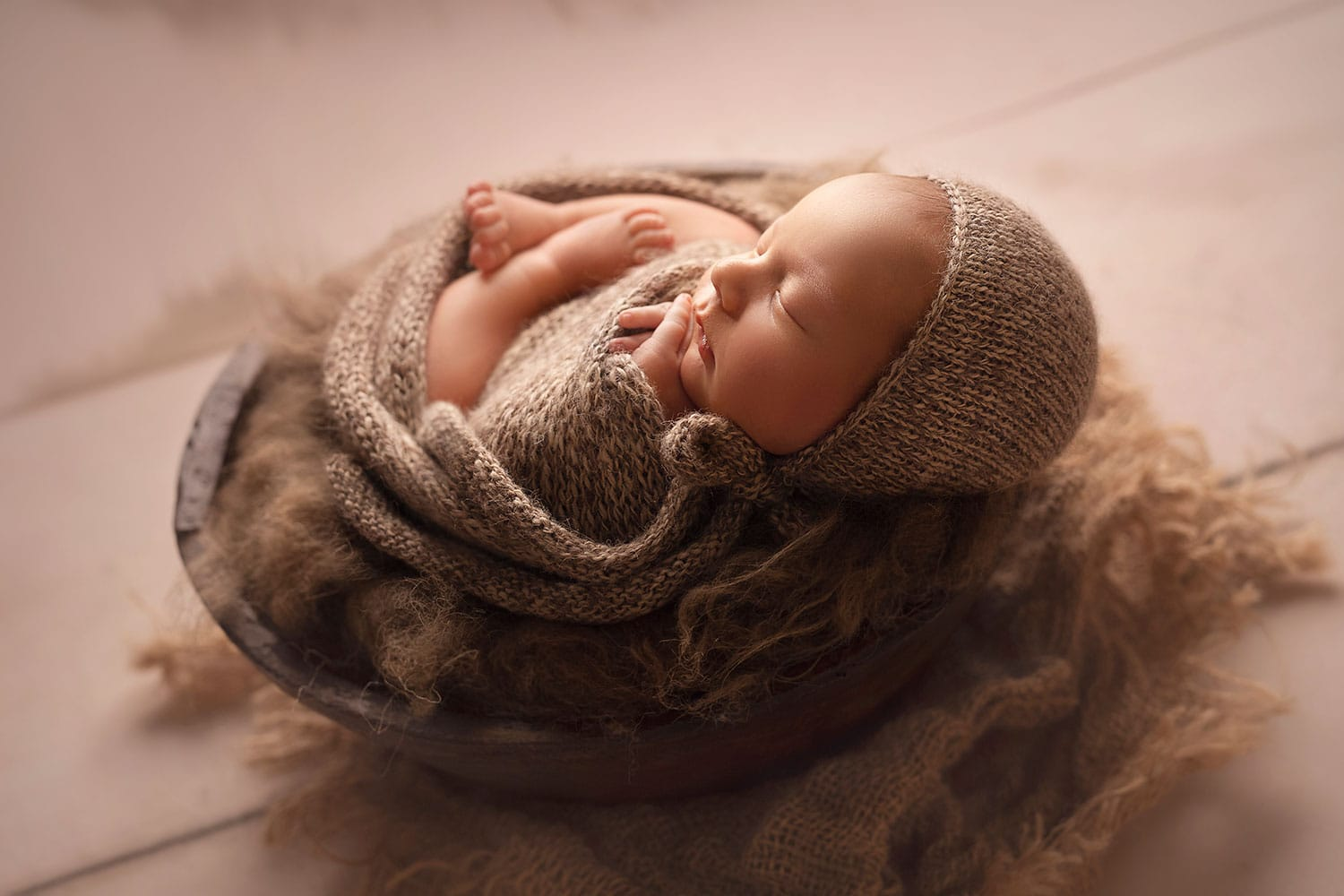profile picture of newborn boy in bowl by Annie Whitaker Photography