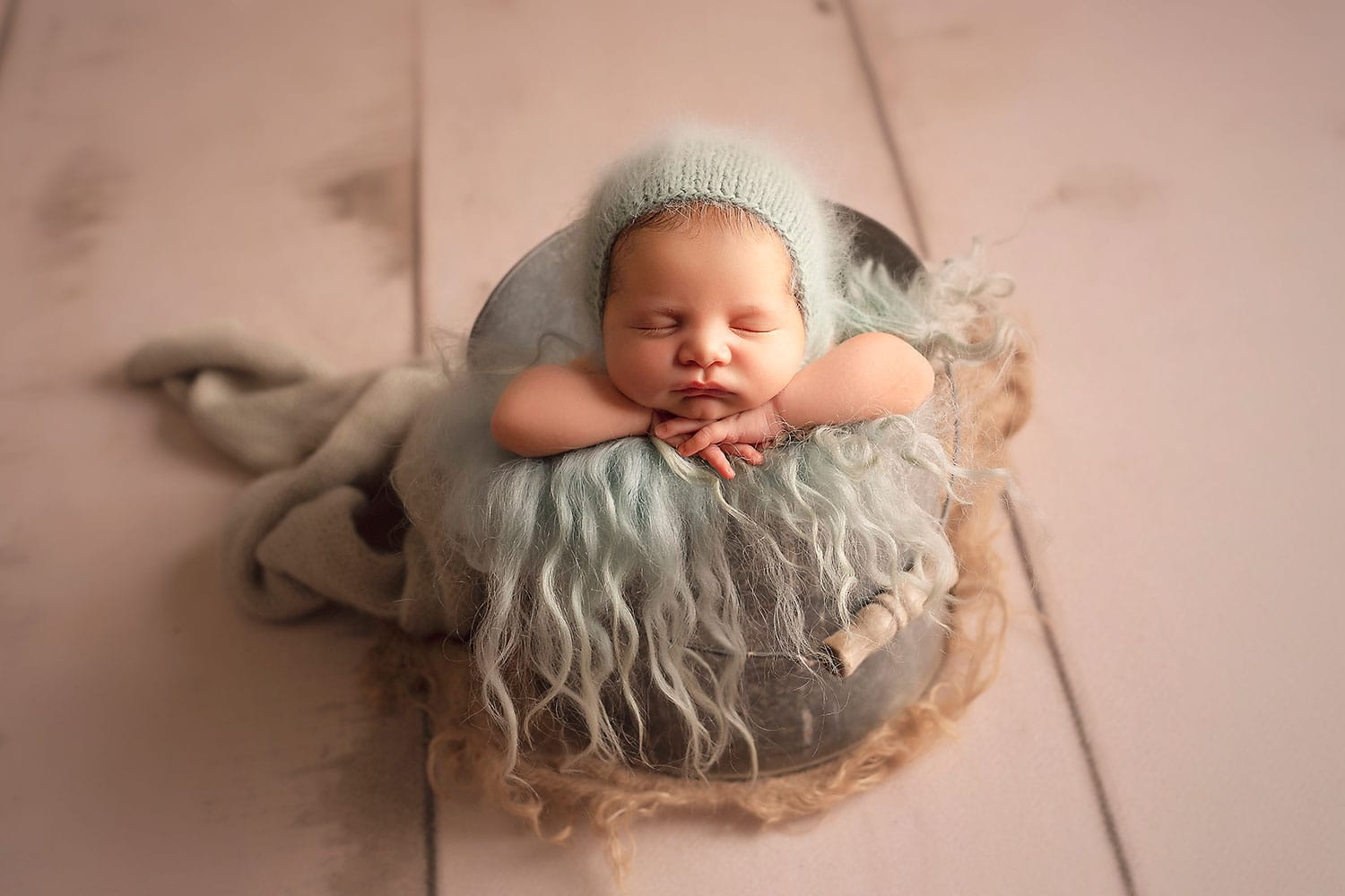 baby boy in bucket by Annie Whitaker Photography
