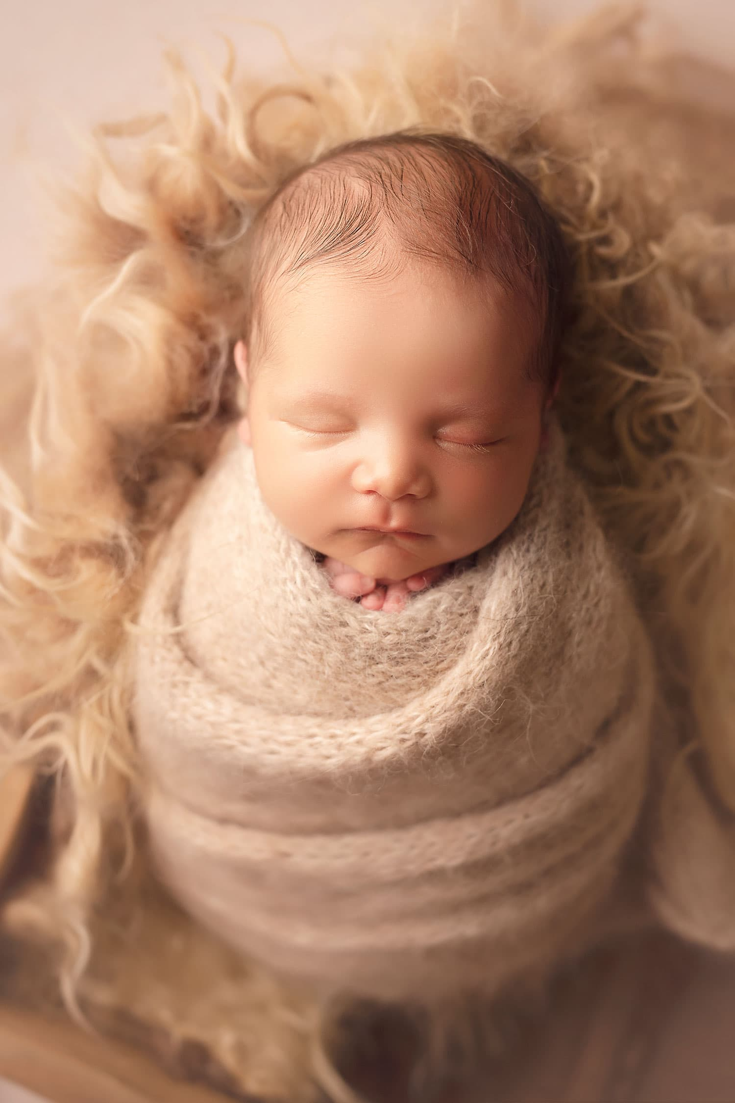 Best newborn wrapping by Annie Whitaker Photography