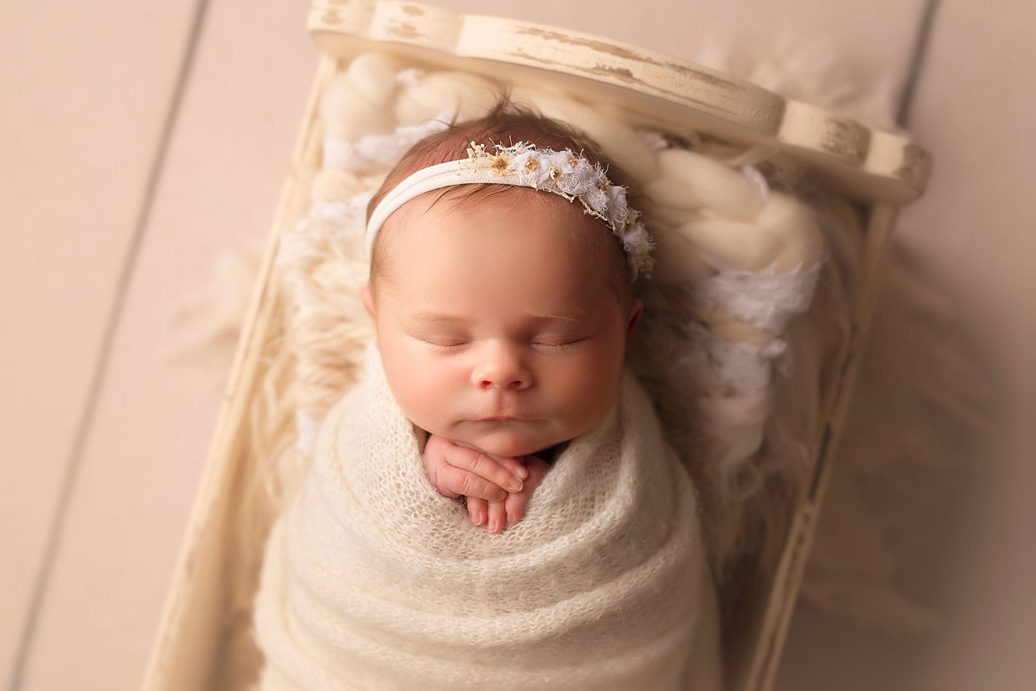 baby in bed by Annie Whitaker Photography