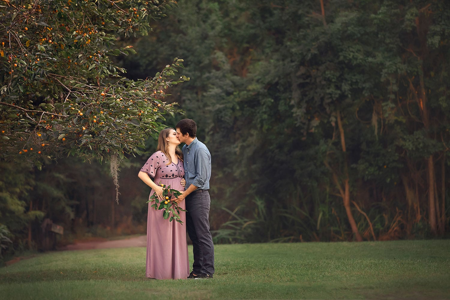 Awaiting baby under an orange tree by Annie Whitaker Photography