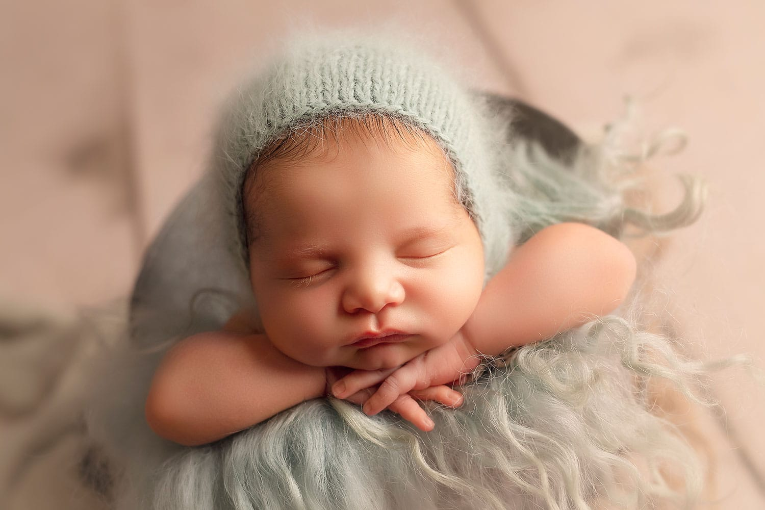 baby boy on blue by Annie Whitaker Photography