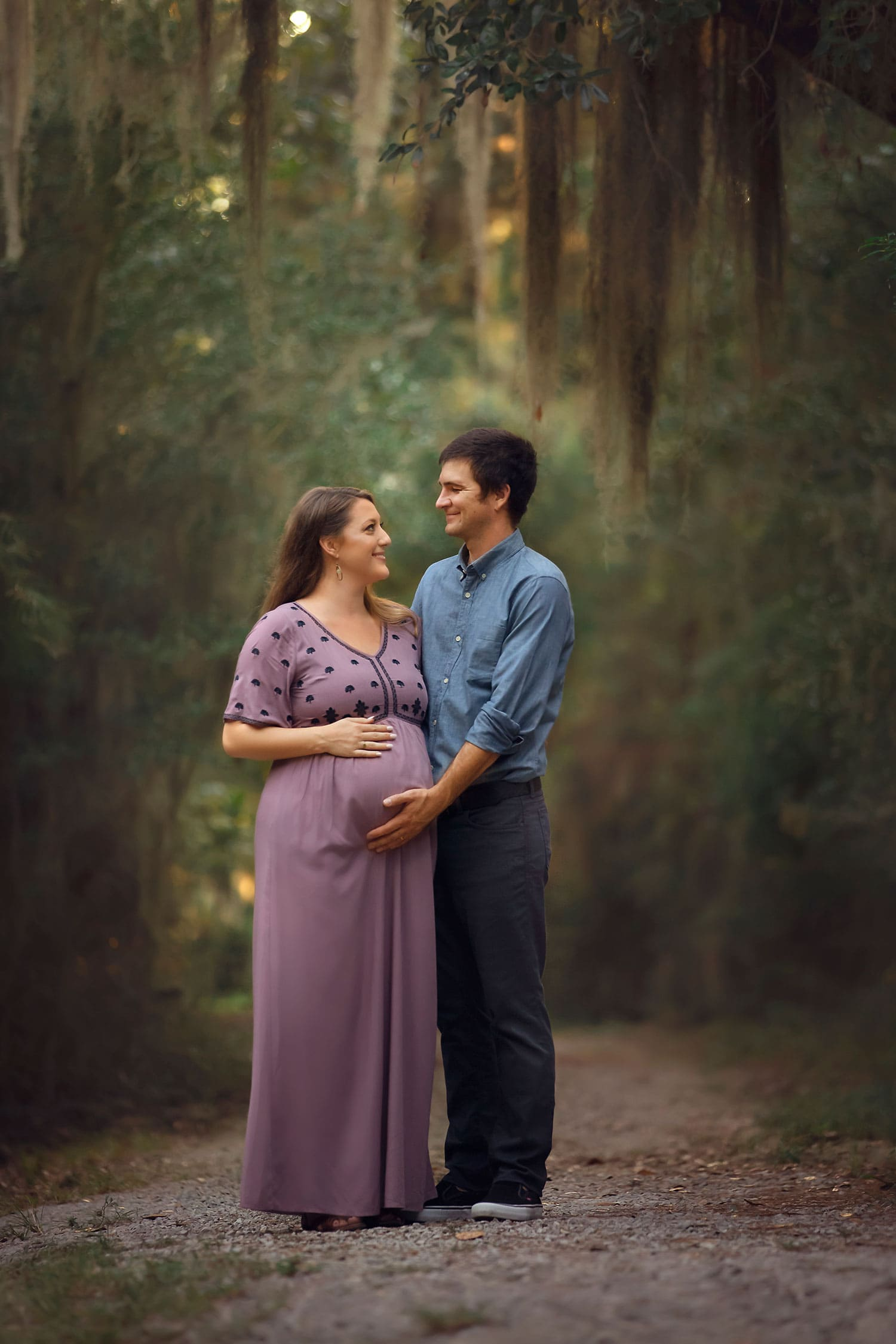 beautiful expectant couple at Fontainebleau State Park in Mandeville LA