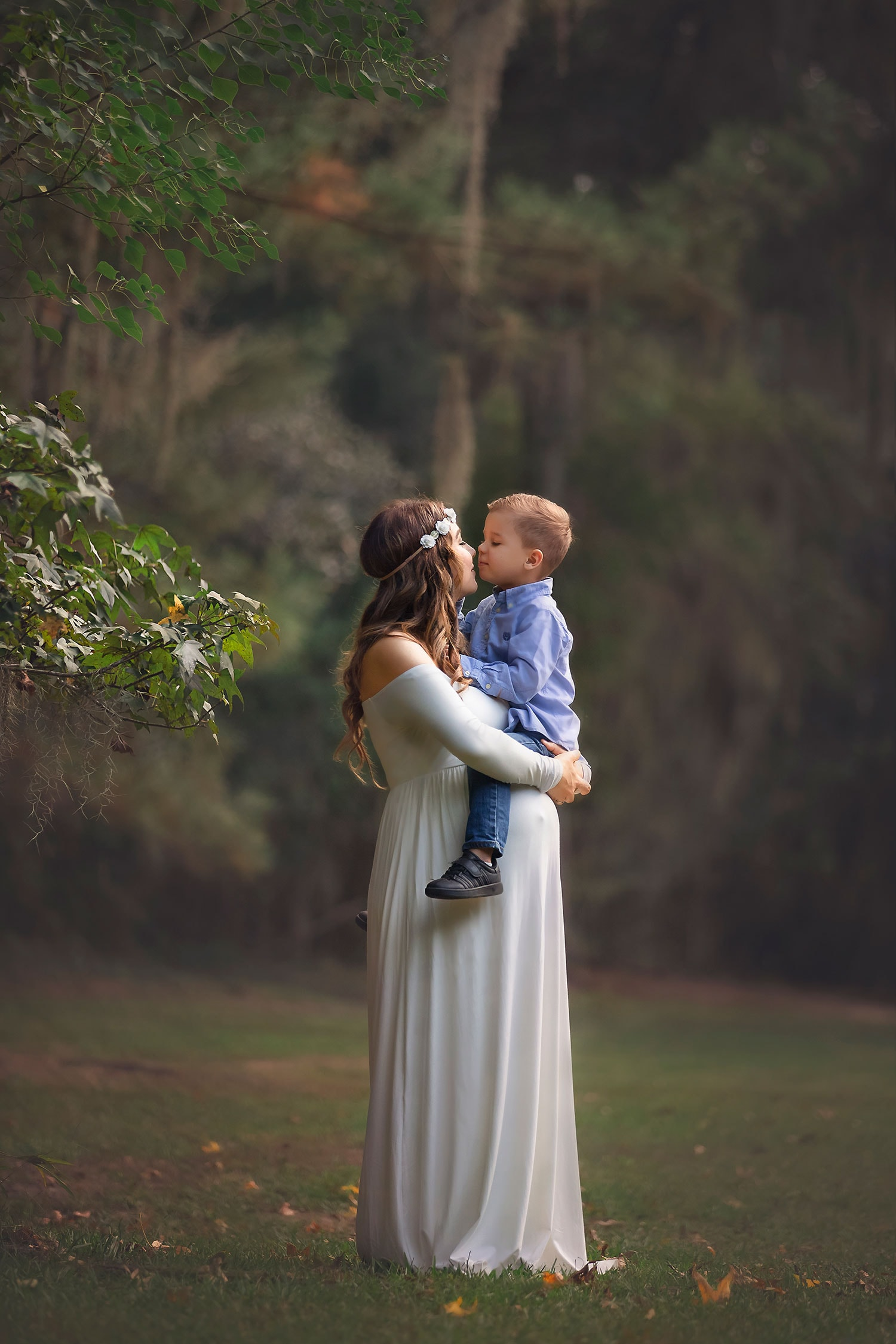 Pregnant mother kissing toddler son by Annie Whitaker Photography