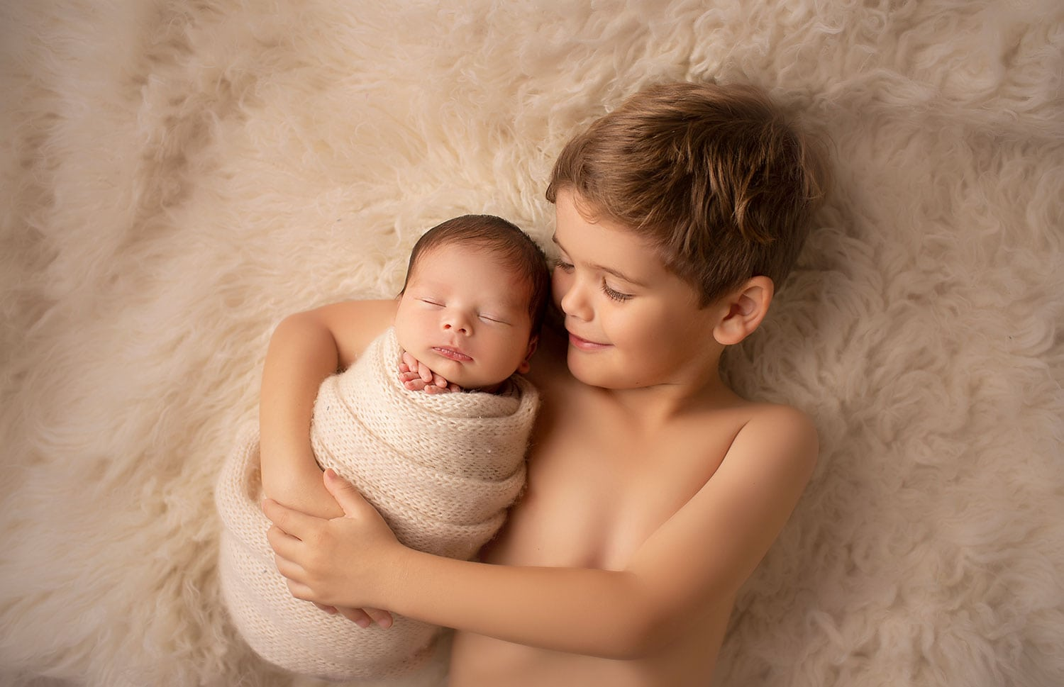four year old brother holding newborn by Annie Whitaker Photography