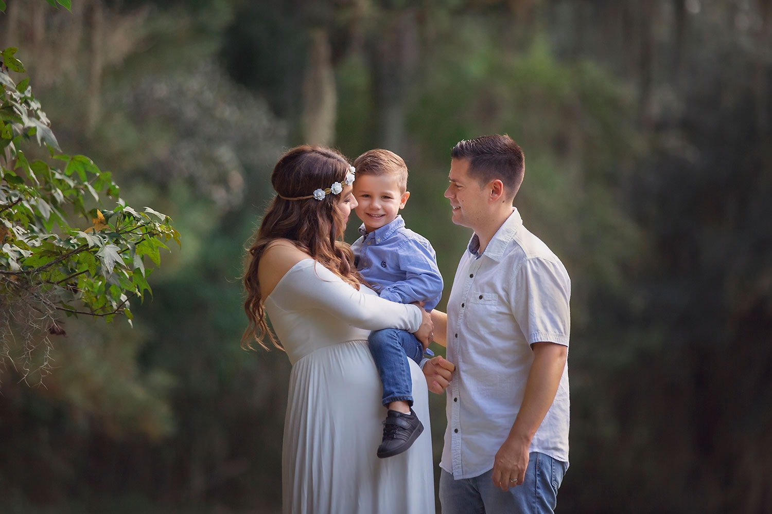 Beautiful family photo with expecting mother by Annie Whitaker Photography