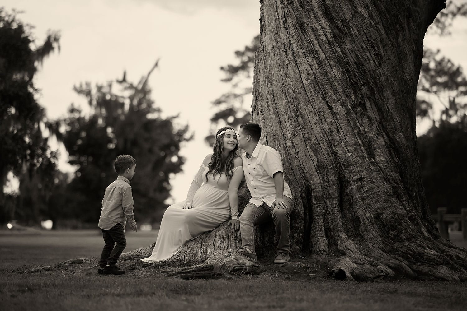 Family of three playing at the end of a photo shoot by Annie Whitaker Photography