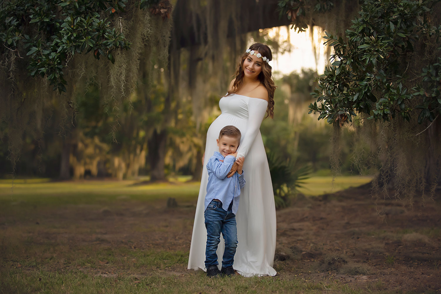 Expecting mother with son at sunset by Annie Whitaker Photography