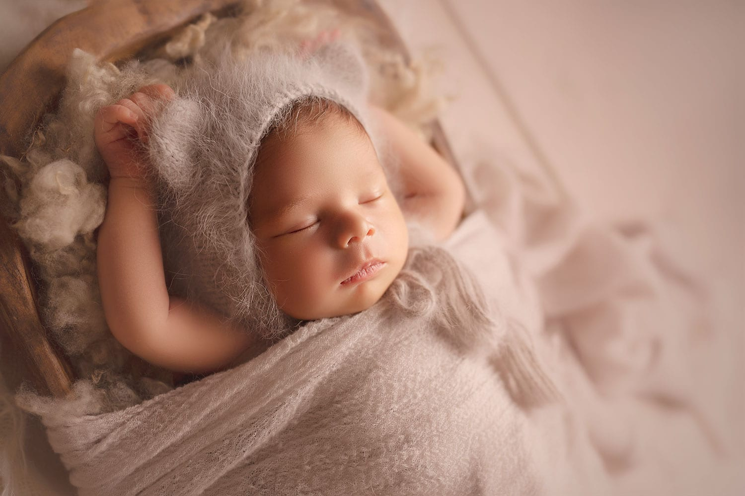 precious newborn baby boy in bear bonnet on Cwtchicoo fluff by Annie Whitaker Photography