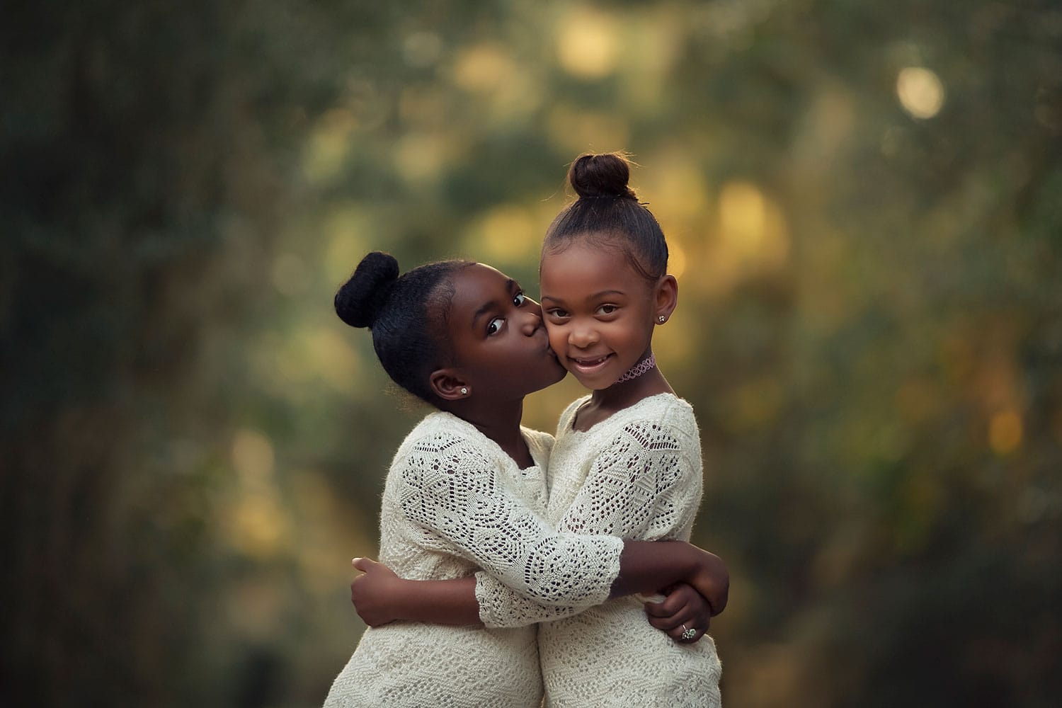 Two sisters hugging each other by Annie Whitaker Photography