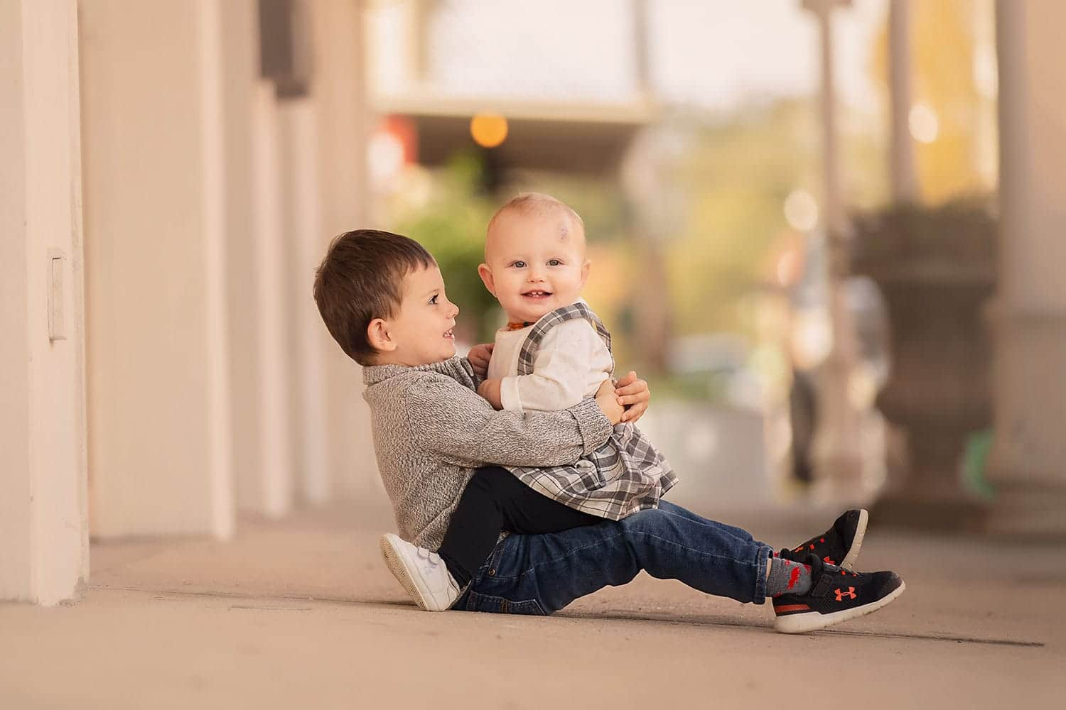 Brother and sister in city by Annie Whitaker Photography