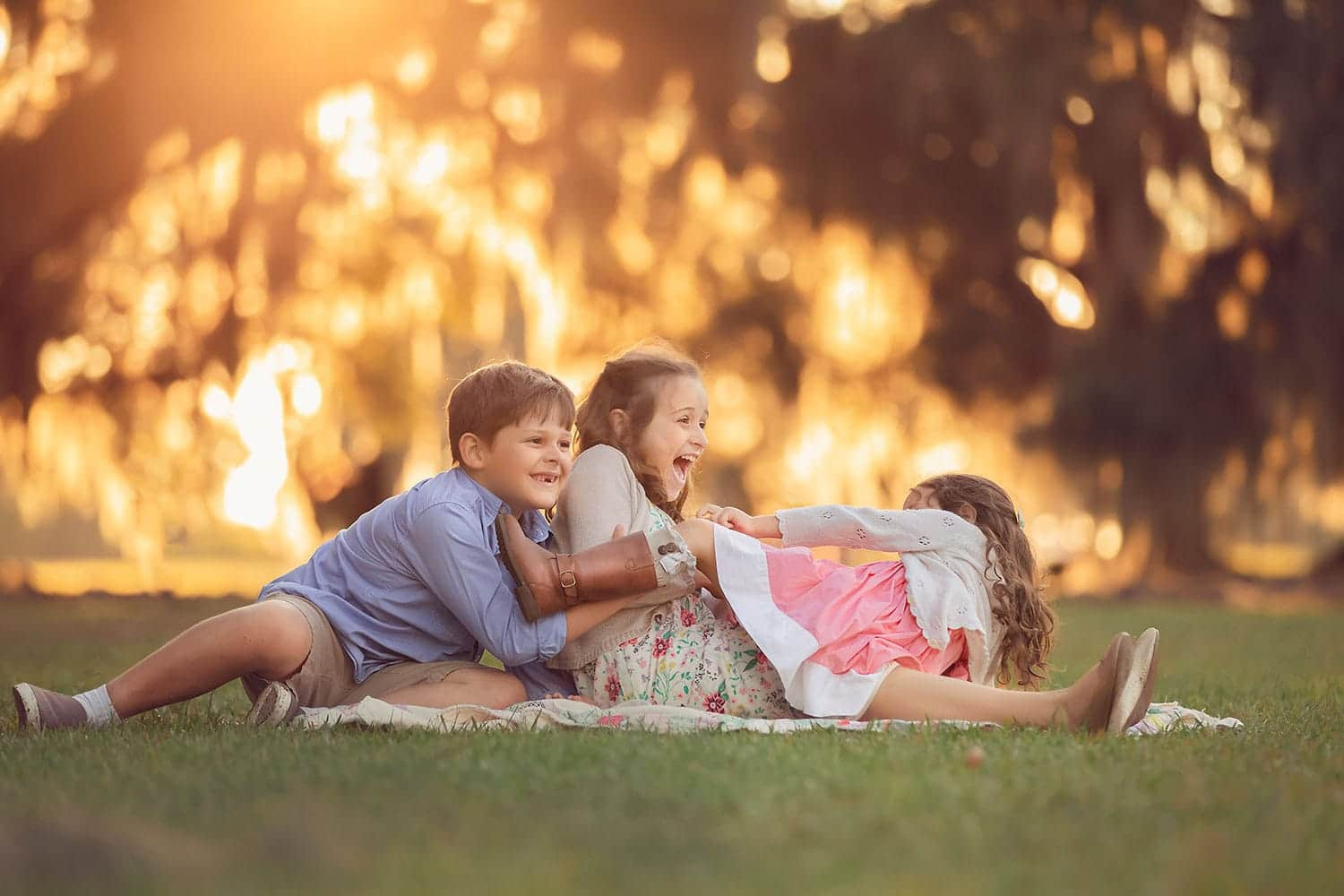 three children at sunset by Annie Whitaker Photography