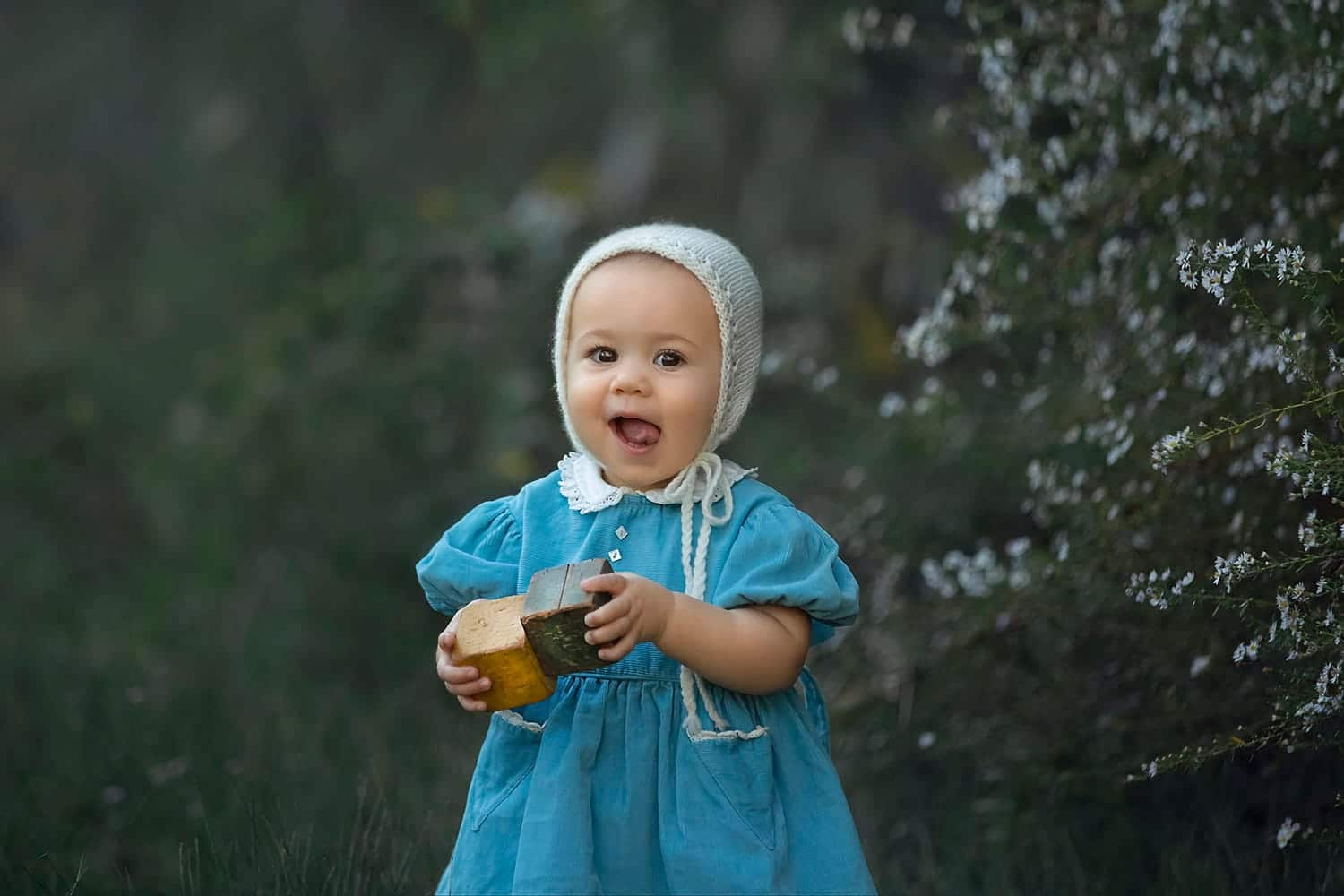 precious baby girl wearing bonnet by Annie Whitaker Photography
