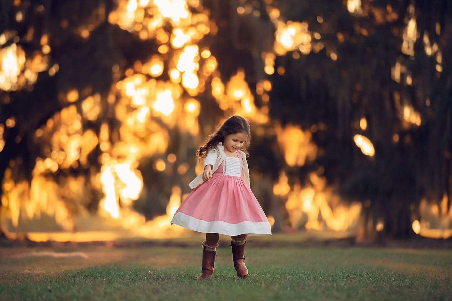 3 year old girl twirling at sunset by Annie Whitaker Photography