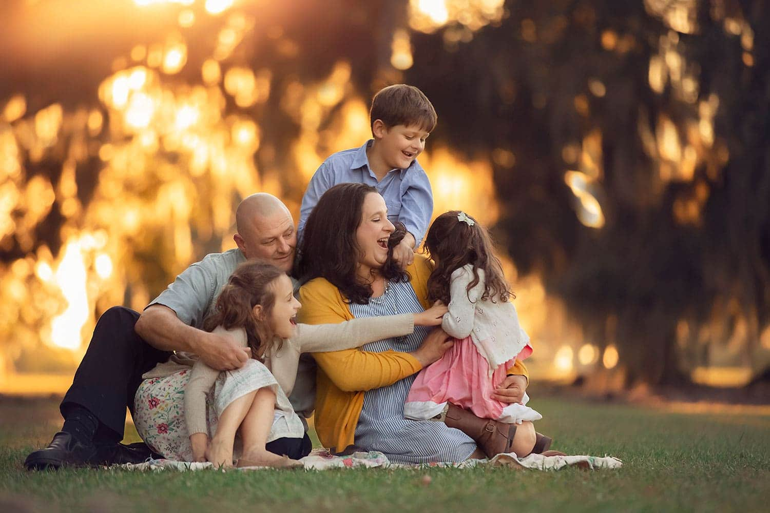 family tickle fight at sunset by Annie Whitaker Photography