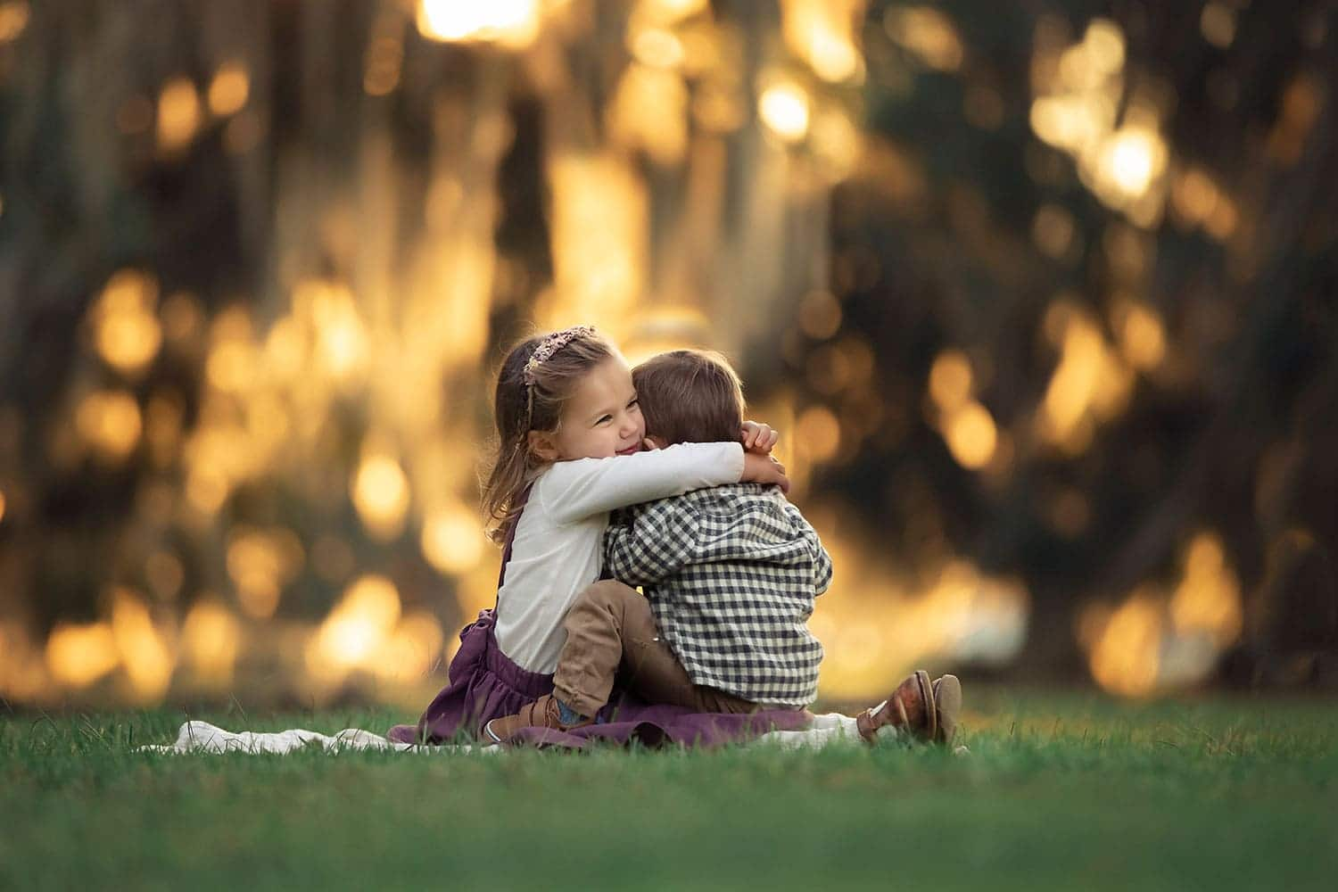 toddler girl holding baby brother at sunset by Annie Whitaker Photography