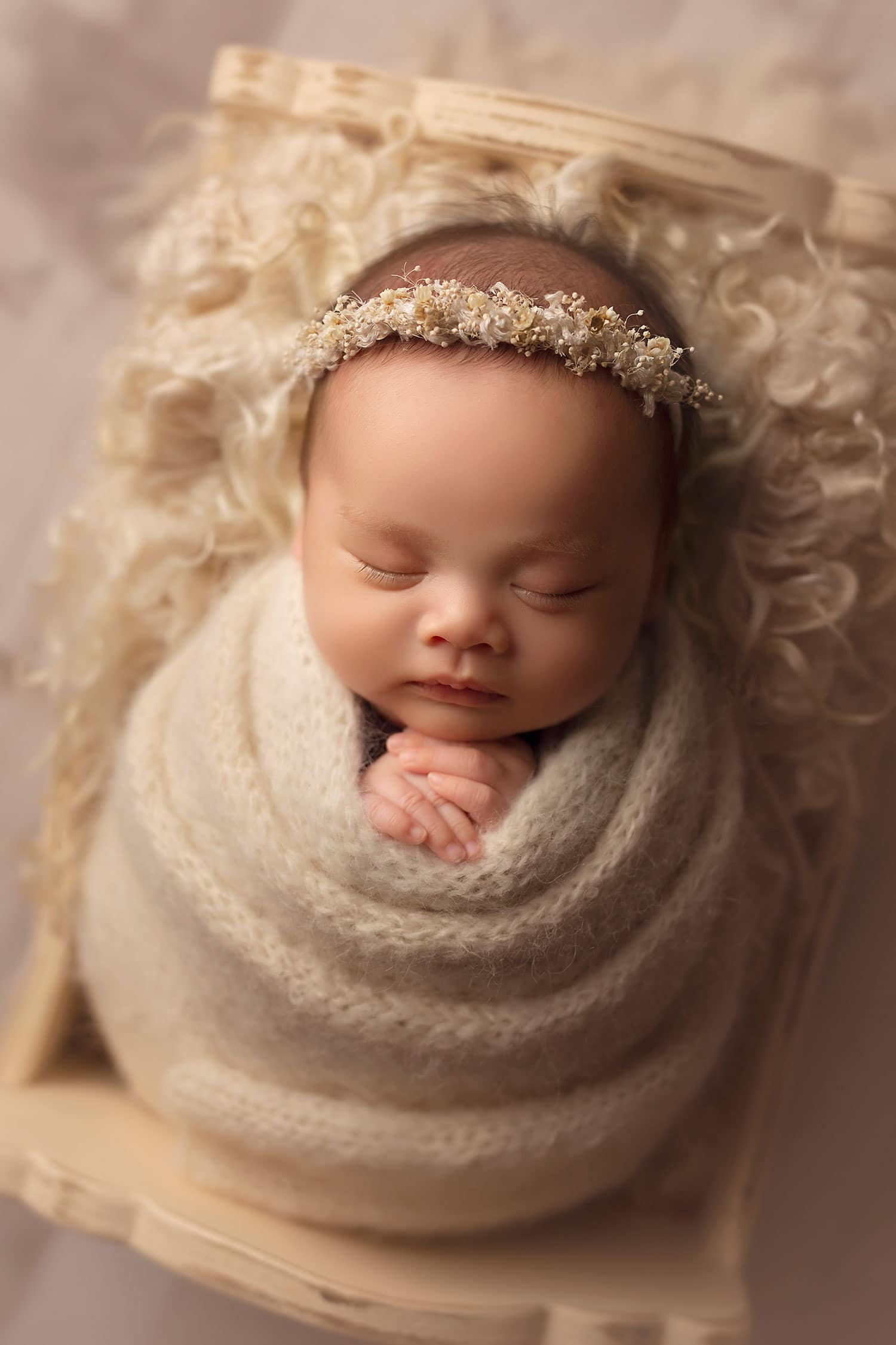 Baby girl in cream set up by Annie Whitaker Photography