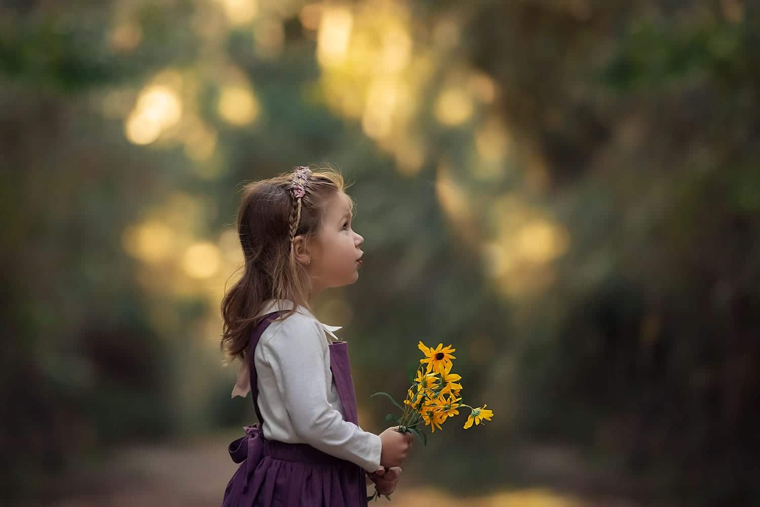 beautiful toddler holding flowers by Annie Whitaker Photography