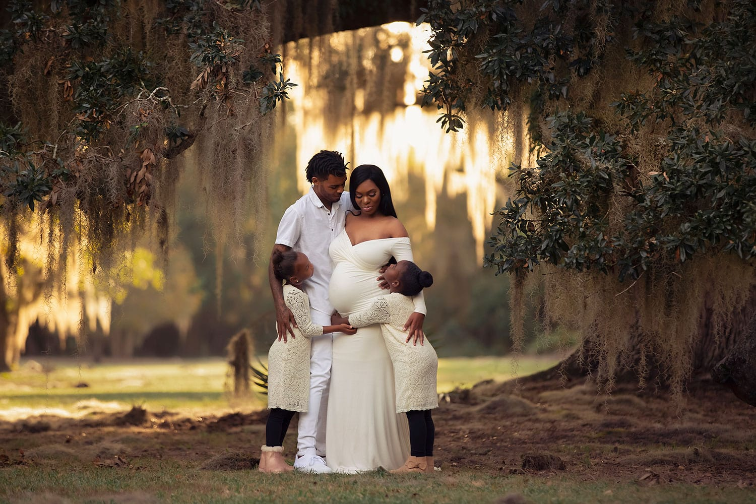Family of four under oak trees by Annie Whitaker Photography
